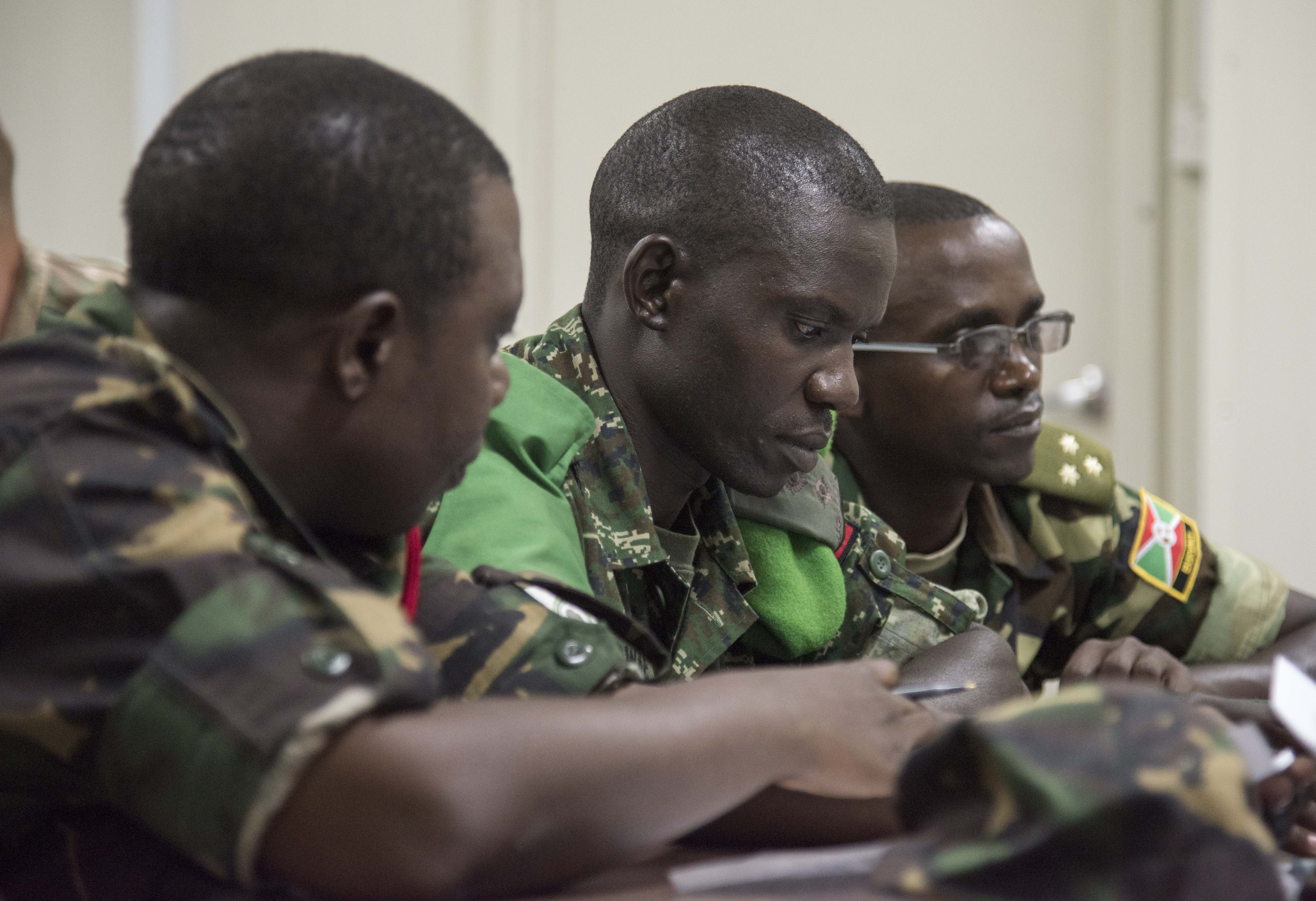 Military members from Tanzania, Uganda and Burundi prepare for simulated interaction with local media during the Public Information Officer Conference, hosted by Combined Joint Task Force-Horn of Africa, at Camp Lemonnier, Djibouti, Nov. 4, 2015. The exercise enabled participants to practice building report with media to promote mutually beneficial relationships.