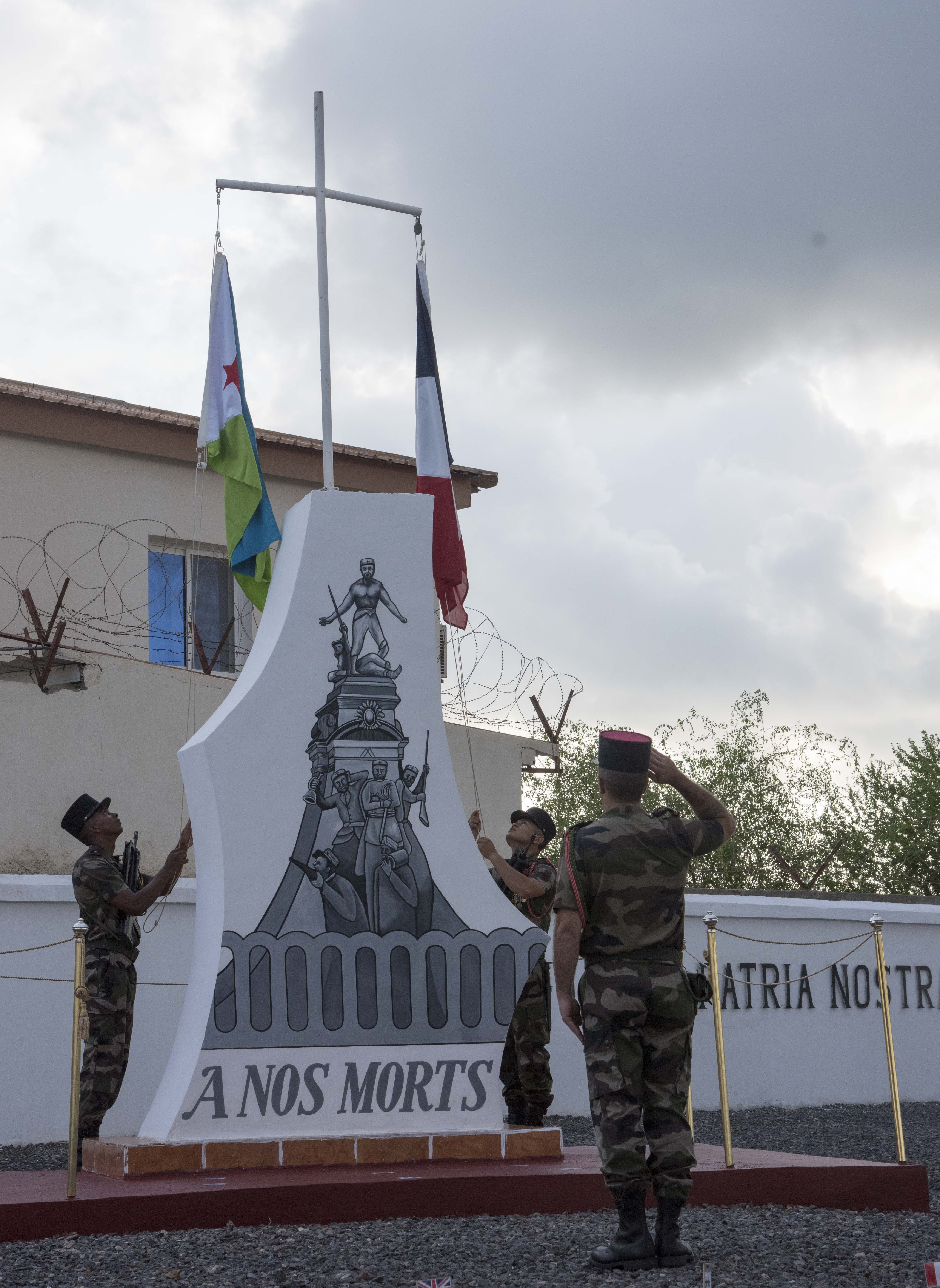 French Foreign Legionnaires raise the flags of Djibouti and France prior to a remembrance ceremony, Nov. 11, 2015, at the military cemetery in Djibouti. The flags were raised prior to the start of the Armistice Day ceremony.