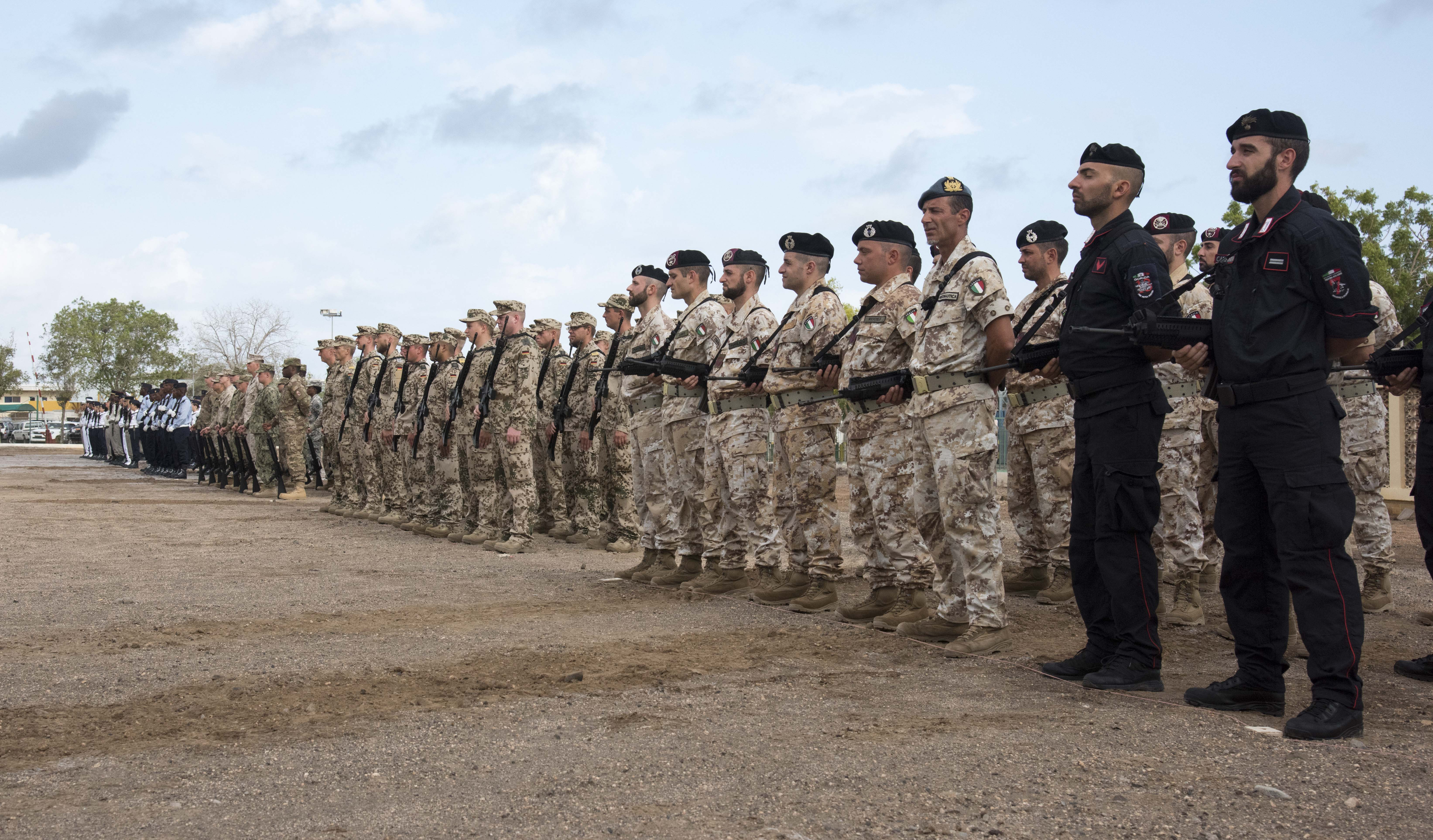 Troops stand in formation during the Armistice Day ceremony at the French Marine Base, Nov. 11, 2015. Participants stationed in Djibouti from seven countries joined the ceremony commemorating the end of World War I.