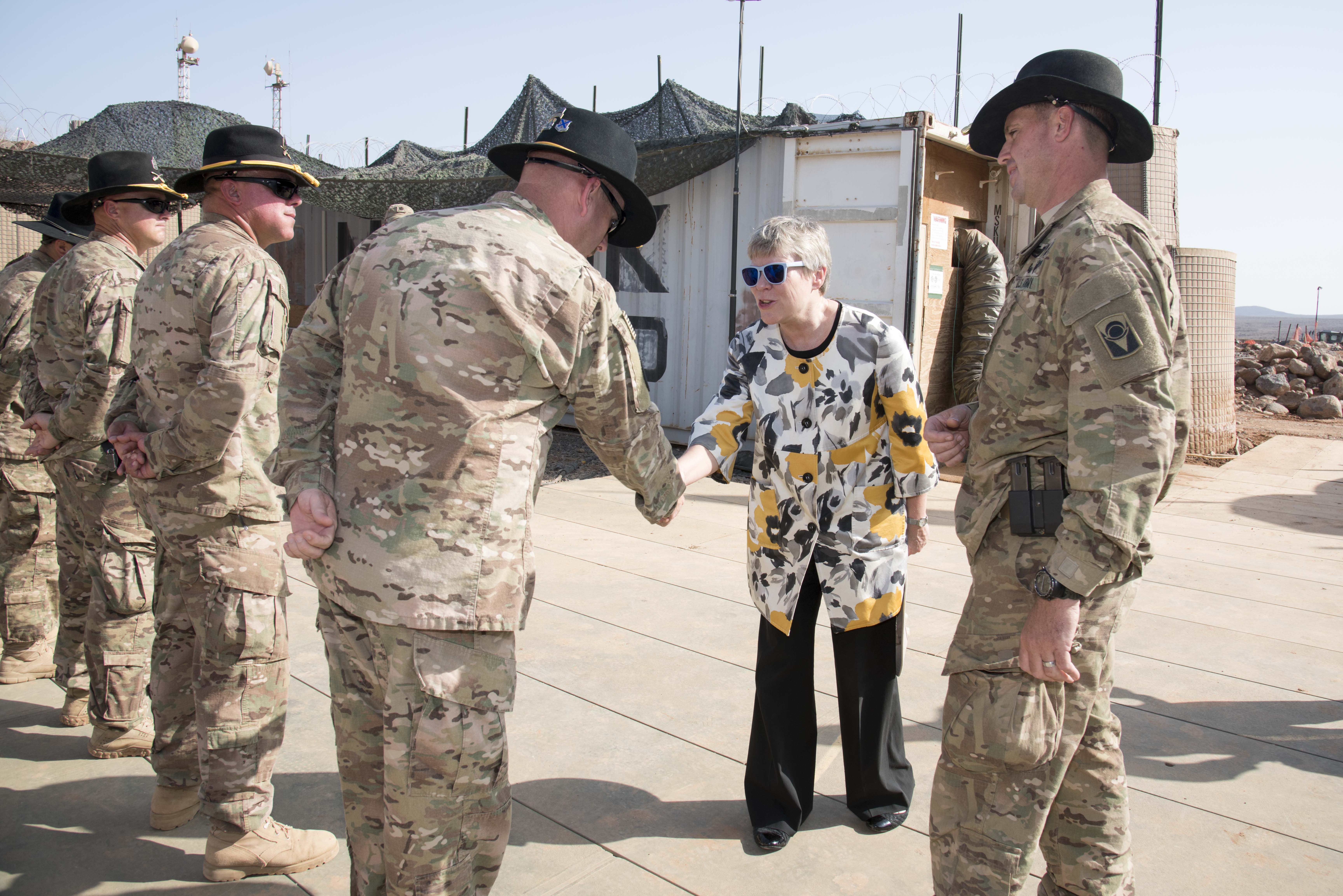 Under Secretary of State for Arms Control and International Security Rose Gottemoeller greets soldiers from Bravo Troop, 1st Squadron, 153rd Cavalry Regiment assigned to Chebelley Airfield, Djibouti, Nov. 14, 2015. Gottemoeller met with service members from Chebelley and Camp Lemonnier during her tour of Djibouti.  As Under Secretary, Gottemoeller advises the Secretary of State on arms control, nonproliferation and disarmament.