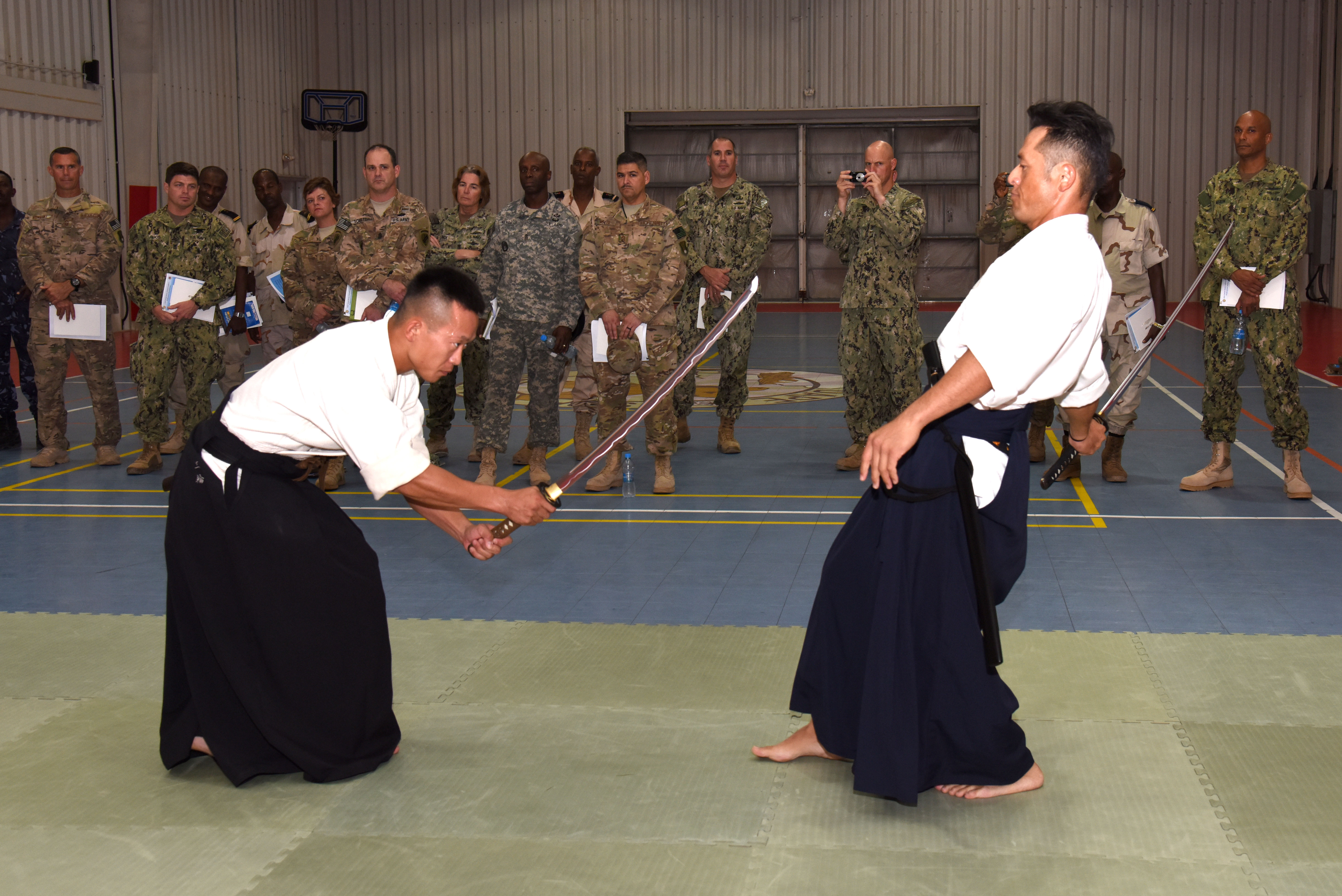 Participants from the Joint Forces Senior Enlisted Professional Development Course view a traditional swordsmanship demonstration at the Japan base in Djibouti, Nov. 24, 2015. The Japan Self-Defense Forces hosted the second gathering of senior enlisted members to share their culture and mission. (U.S. Air Force photo by  Staff Sgt. Victoria Sneed)