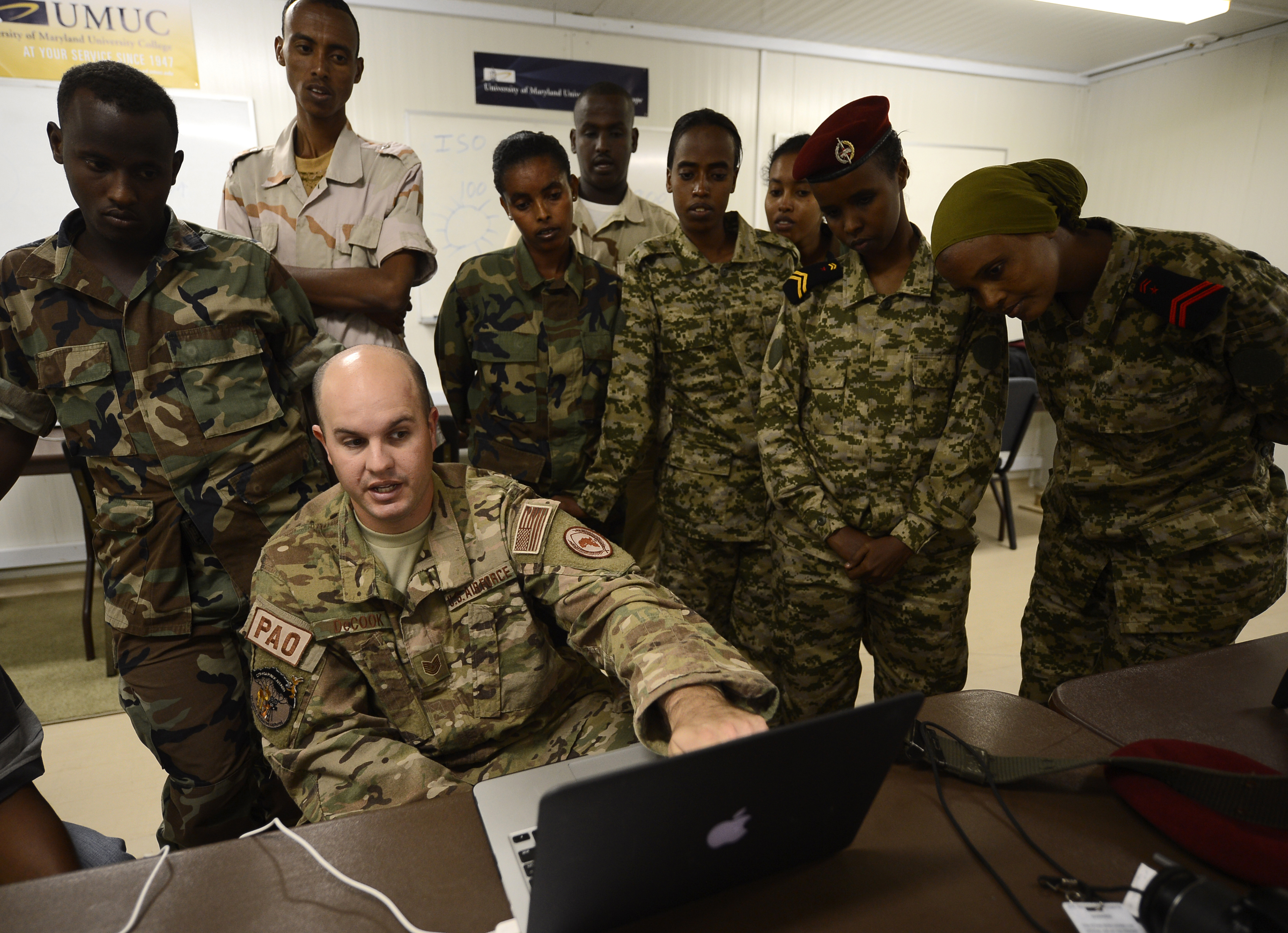 Tech. Sgt. Daniel DeCook, Combined Joint Task Force-Horn of Africa photojournalism NCOIC, explains U.S. imagery storage techniques to members of the Djibouti Armed Forces (FAD) Dec. 2, 2015, at Camp Lemonnier, Djibouti. Similar to U.S. military journalists, the Djiboutian photographers and videographers gather still and video imagery for mission documentation, media distribution and operational purposes. The engagement with the FAD enabled participants to share their knowledge and experiences with each other and build relationships between the two militaries. (U.S. Air Force photo by Senior Airman Peter Thompson)