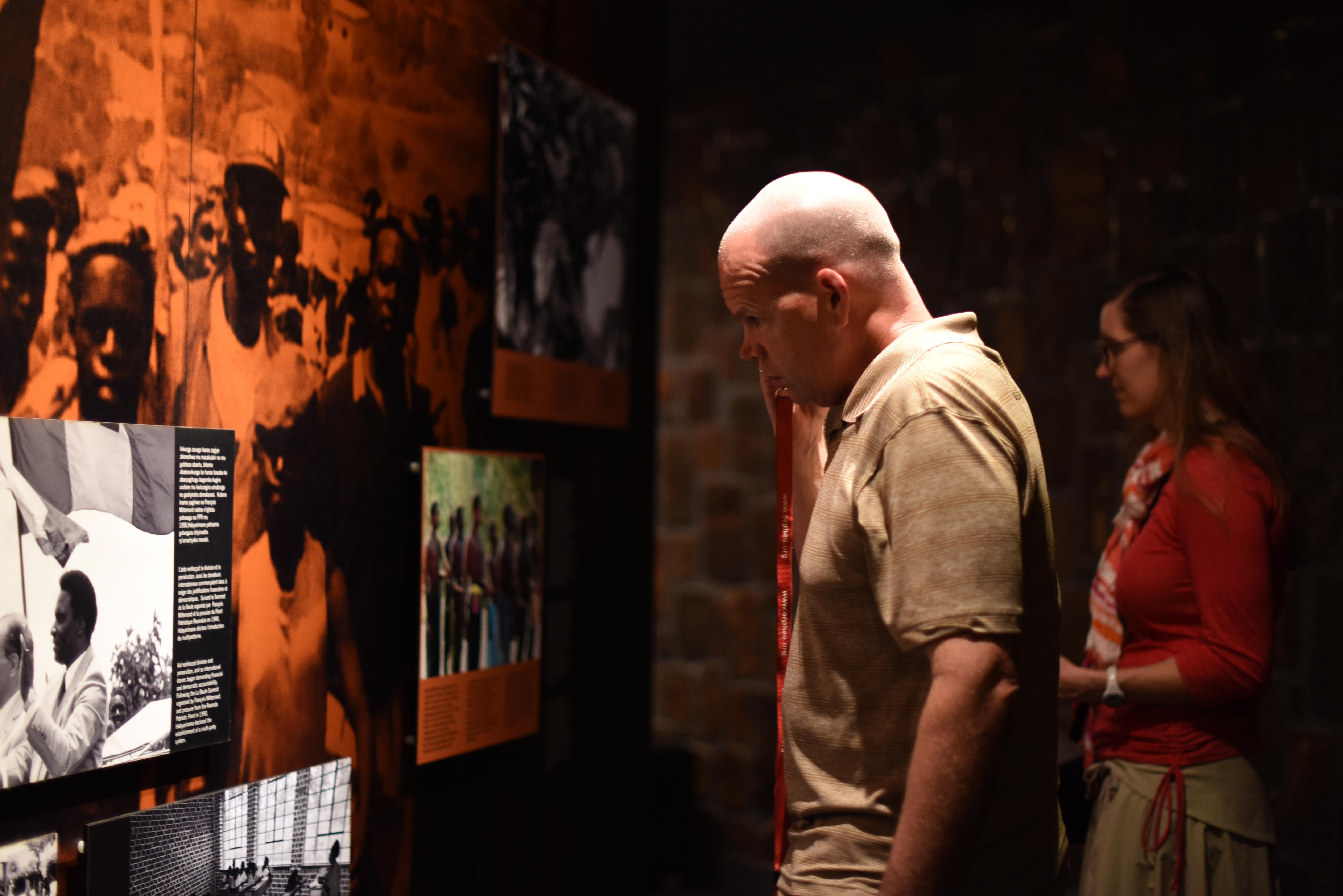 U.S. Navy Lt. Steven Hunt and U.S. Marine Corps Maj. Bevin Keen from Combined Joint Task Force-Horn of Africa listen to introductions at the Genocide Memorial Museum in Kigali, Rwanda, Dec. 16, 2015. The museum exhibits photos, media and artwork related to the 1994 genocide against the Tutsi in Rwanda. Survivors provided testimony to help tell the story for future generations. (U.S. Air Force photo by Staff Sgt. Victoria Sneed)