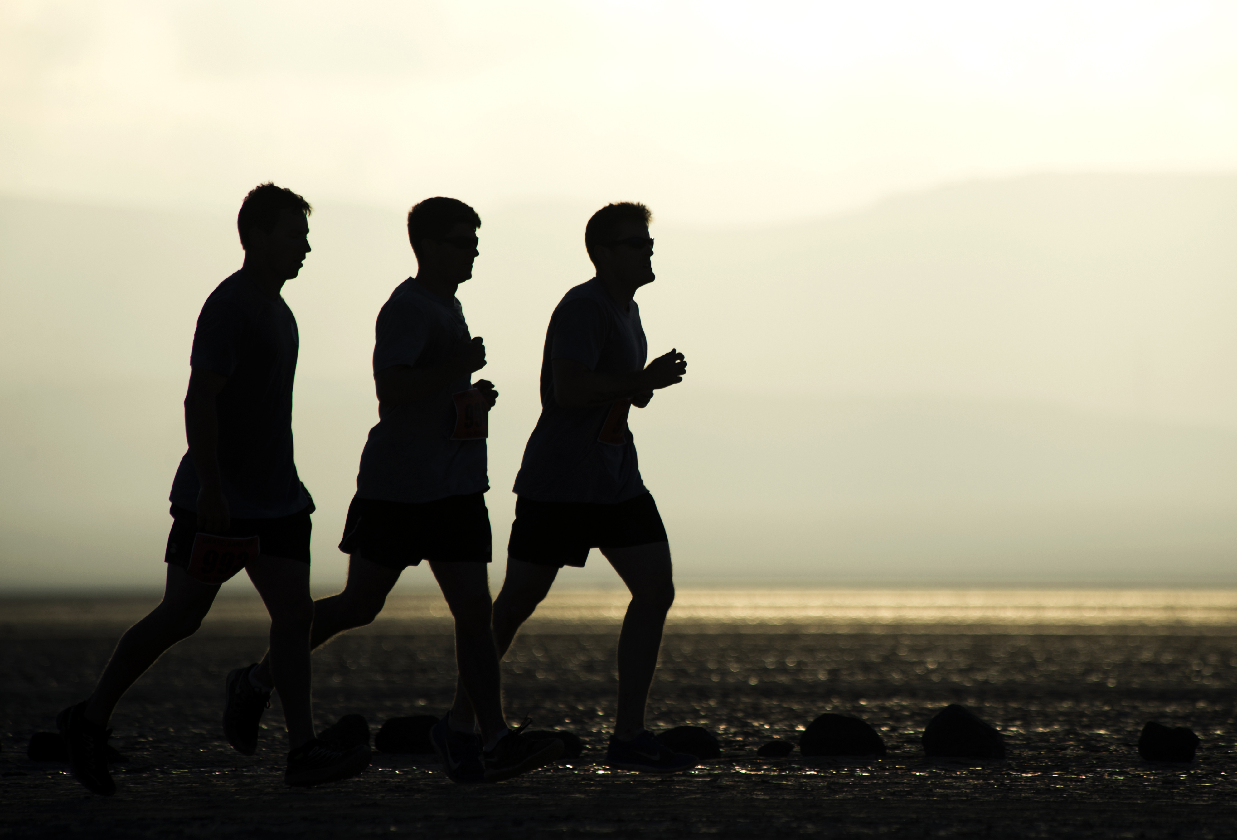 Members of Camp Lemonnier run during the 2015 Grand Bara 15K race Dec. 17, 2015, in Djibouti. The Grand Bara is a desert in southern Djibouti consisting of large areas of sand flats, with sparse, semi-desert and desert grasses and scrub vegetation.  (U.S. Air Force photo by Senior Airman Peter Thompson)