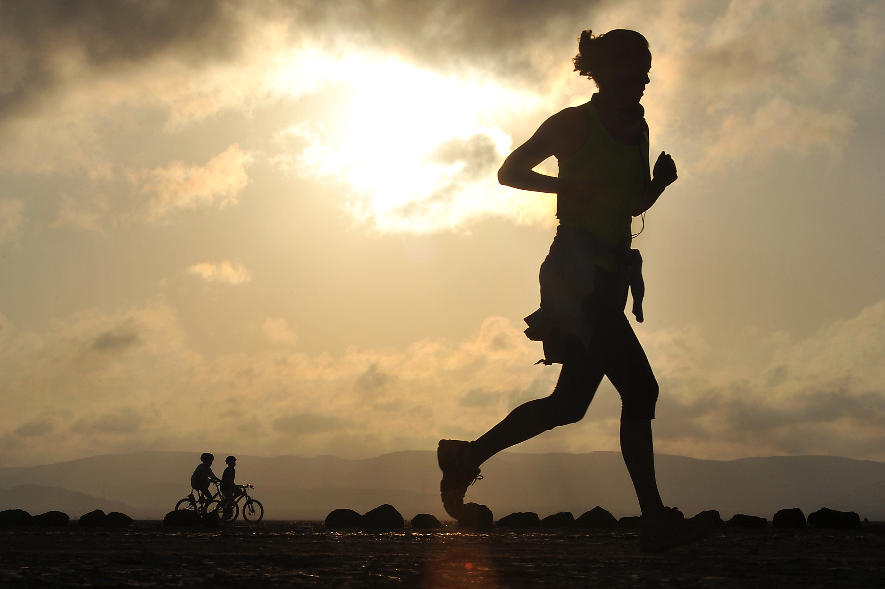 A runner makes her way across the Grand Bara Desert during the Annual Grand Bara 15K race Dec. 17, 2015, in Djibouti. More than 1,500 service members and civilians representing France, Djibouti, U.S., Japan, Germany and others participated in the race. (U.S. Air Force photo by Tech. Sgt. Dan DeCook)