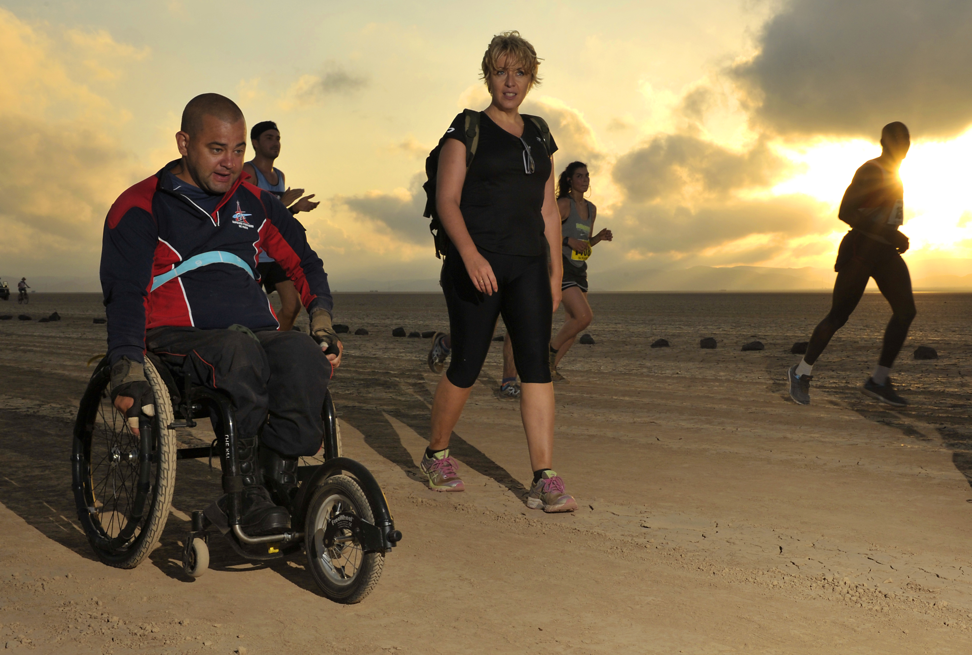French Army Sgt. Vincent Dorival, Paris Fire Brigade, treks across the Grand Bara Desert during the Annual Grand Bara 15K race Dec. 17, 2015, in Djibouti. Dorival was injured while on duty and is paralyzed from the chest down. (U.S. Air Force photo by Tech. Sgt. Dan DeCook)
