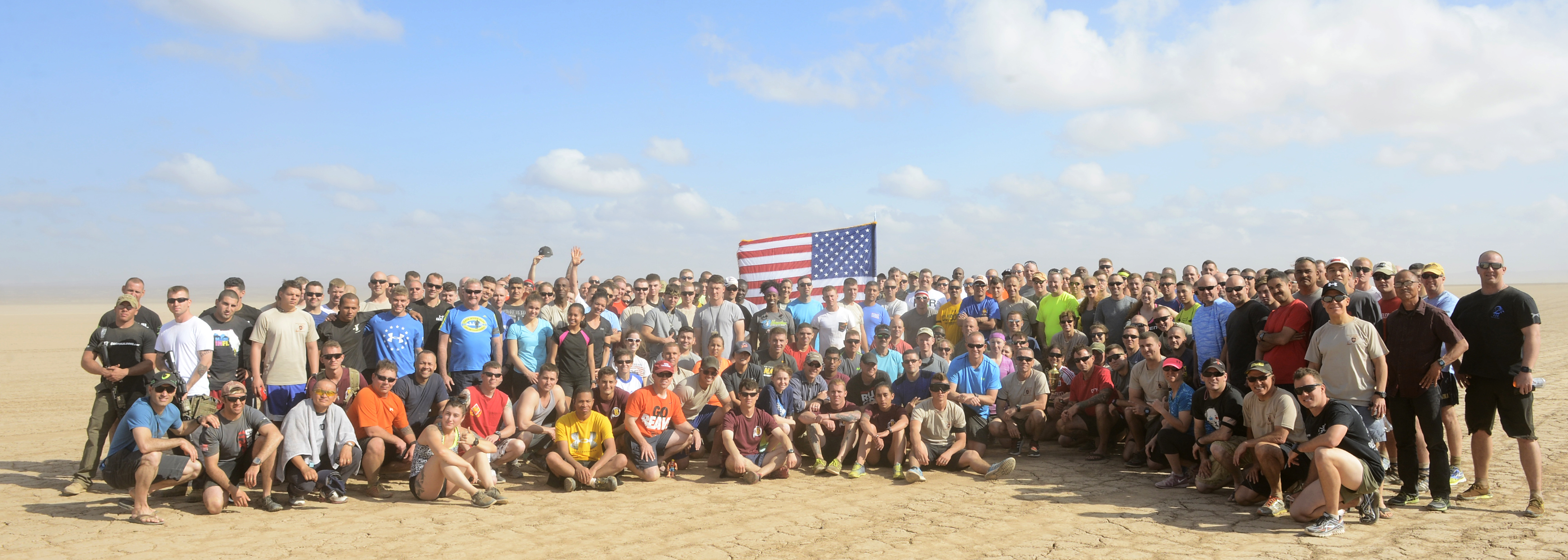 Members of Camp Lemonnier and Combined Joint Task Force-Horn of Africa pose for a group photo after completing the 2015 Grand Bara 15K race in Djibouti Dec. 17, 2015, in Djibouti. More than 1,500 runners from different countries participated in the desert race (U.S. Air Force photo by Tech. Sgt. Dan DeCook)