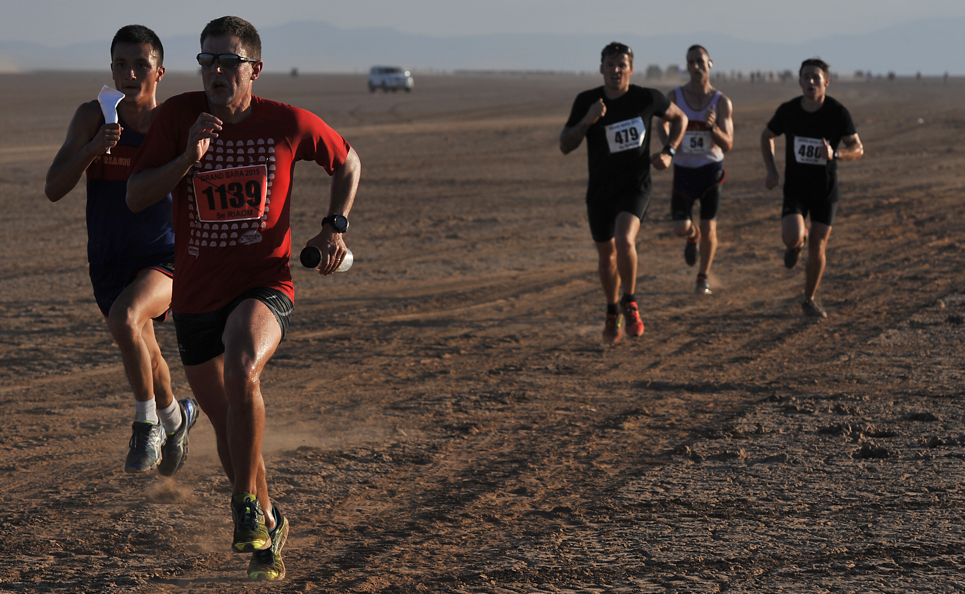 Runners sprint for the finish line in the Grand Bara Desert during the Annual Grand Bara 15K race Dec. 17, 2015, in Djibouti. More than 1,500 service members and civilians representing France, Djibouti, U.S., Japan, Germany and others participated in the race. (U.S. Air Force photo by Tech. Sgt. Dan DeCook)