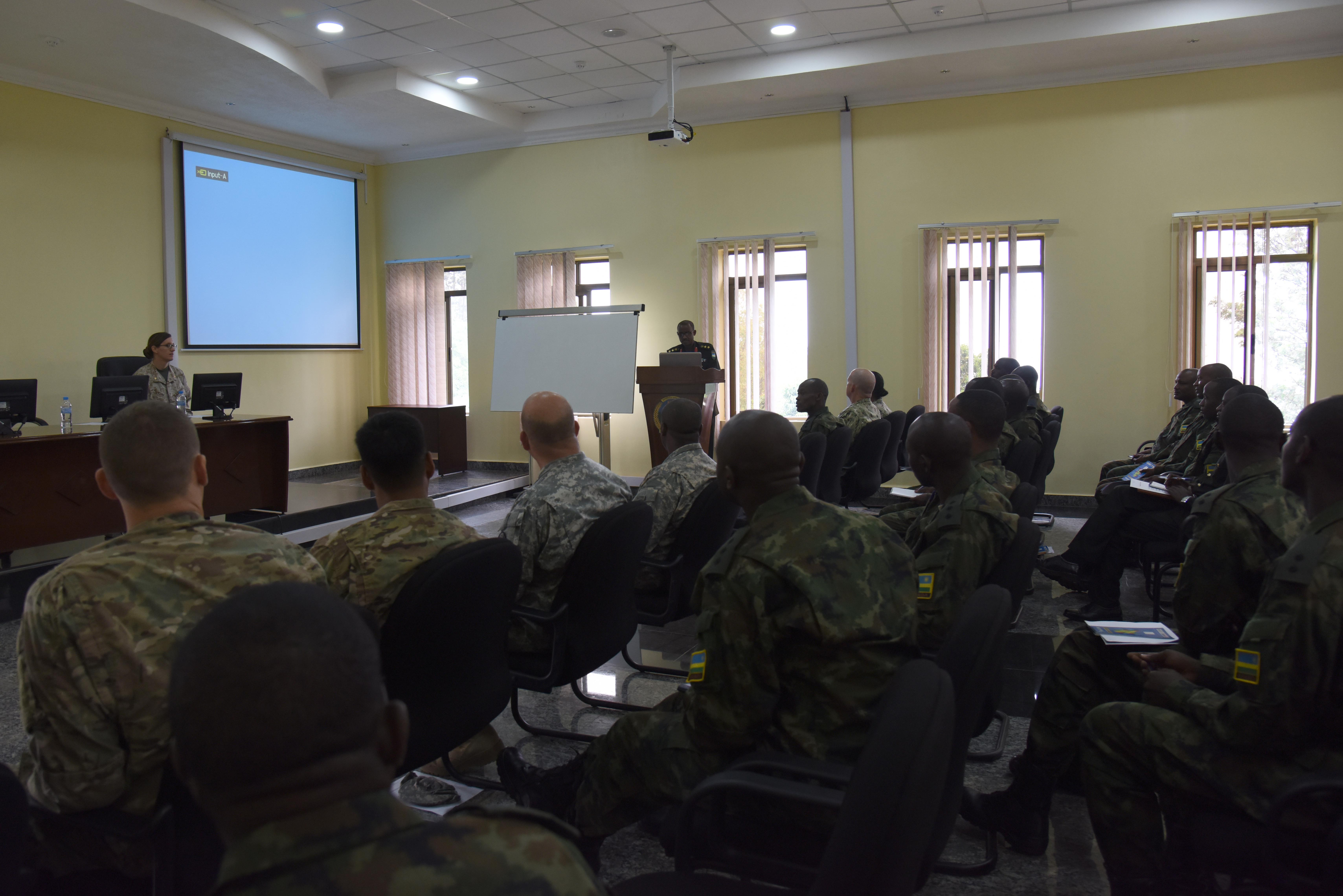 Rwandan Defense Force Col. Faustin Kalisa, Engineering Brigade commander, gives opening remarks for military-to-military sharing of best practices at the RDF Engineering Brigade Headquarters near Kigali, Rwanda, Dec. 15, 2015. Engineers from Combined Joint Task Force–Horn of Africa exchanged information with RDF engineers about how to plan expeditionary base camps from the ground up. (U.S. Air Force photo by Staff Sgt. Victoria Sneed)