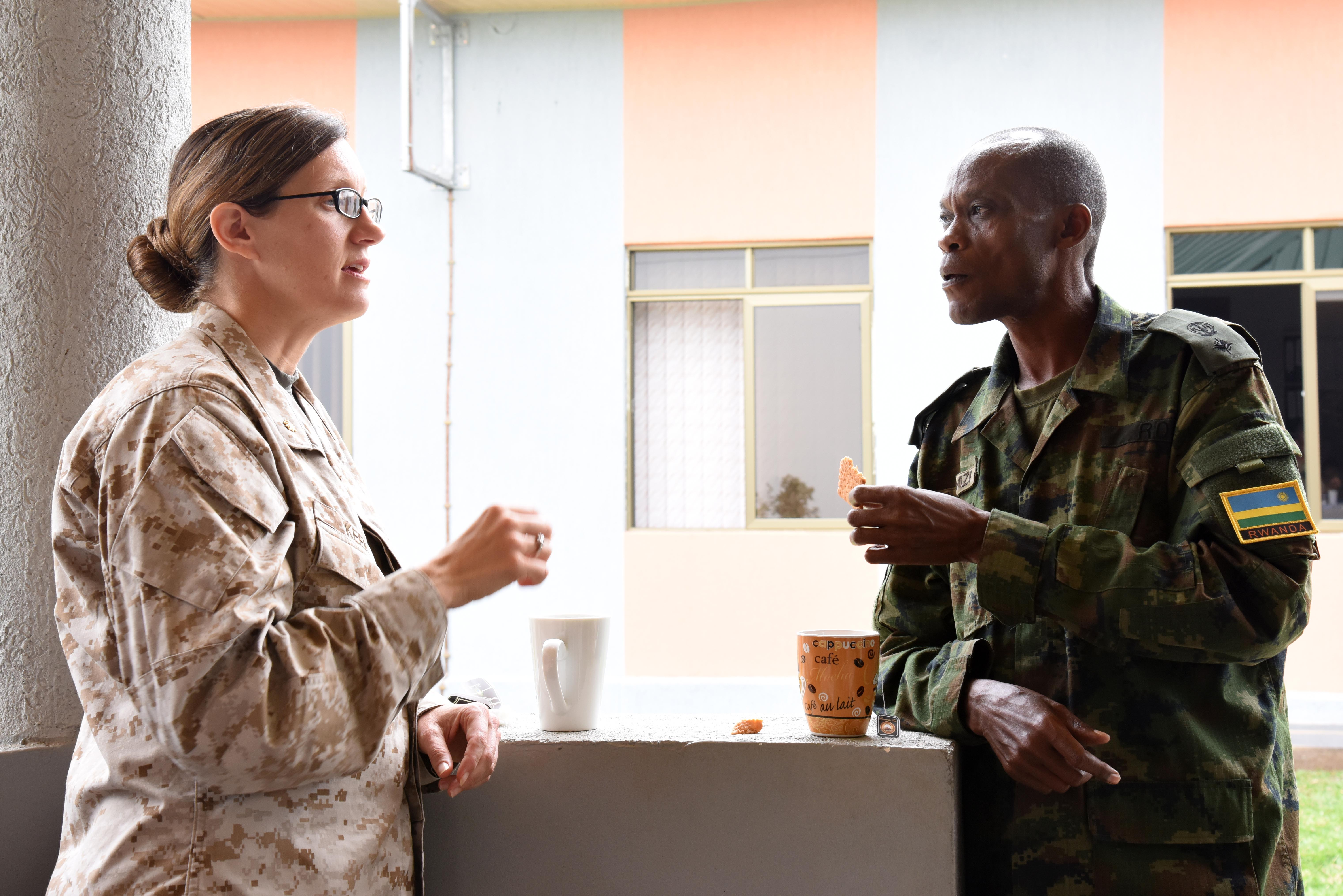 U.S. Marine Corps Maj. Bevin Keen, Combined Joint Task Force–Horn of Africa engineer, speaks with Rwandan Defense Force Lt. Col. John Gahizi, RDF Engineer, during a tea break at the RDF Engineering Brigade Headquarters near Kigali, Rwanda, Dec. 15, 2015. Engineers from CJTF-HOA and RDF exchanged best practices for planning, building, maintaining and breaking down expeditionary base camps. (U.S. Air Force photo by Staff Sgt. Victoria Sneed)