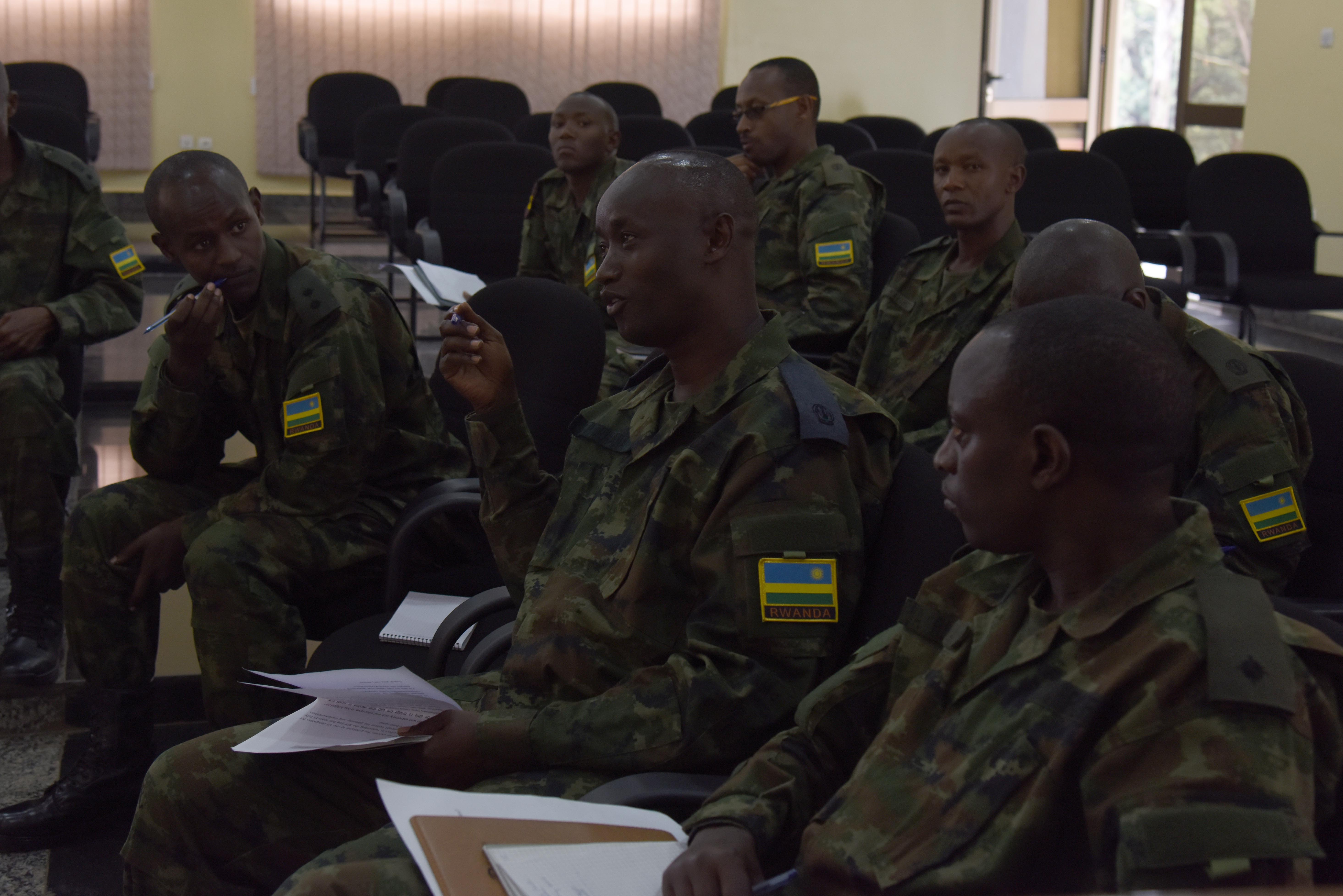 Members of the Rwandan Defense Force ask questions during a military-to-military engagement at the RDF Engineering Brigade Headquarters near Kigali, Rwanda, Dec. 17, 2015. RDF engineers from different specialties gathered to share their common practices of planning expeditionary camps with engineers from Combined Joint Task Force-Horn of Africa. (U.S. Air Force photo by Staff Sgt. Victoria Sneed)