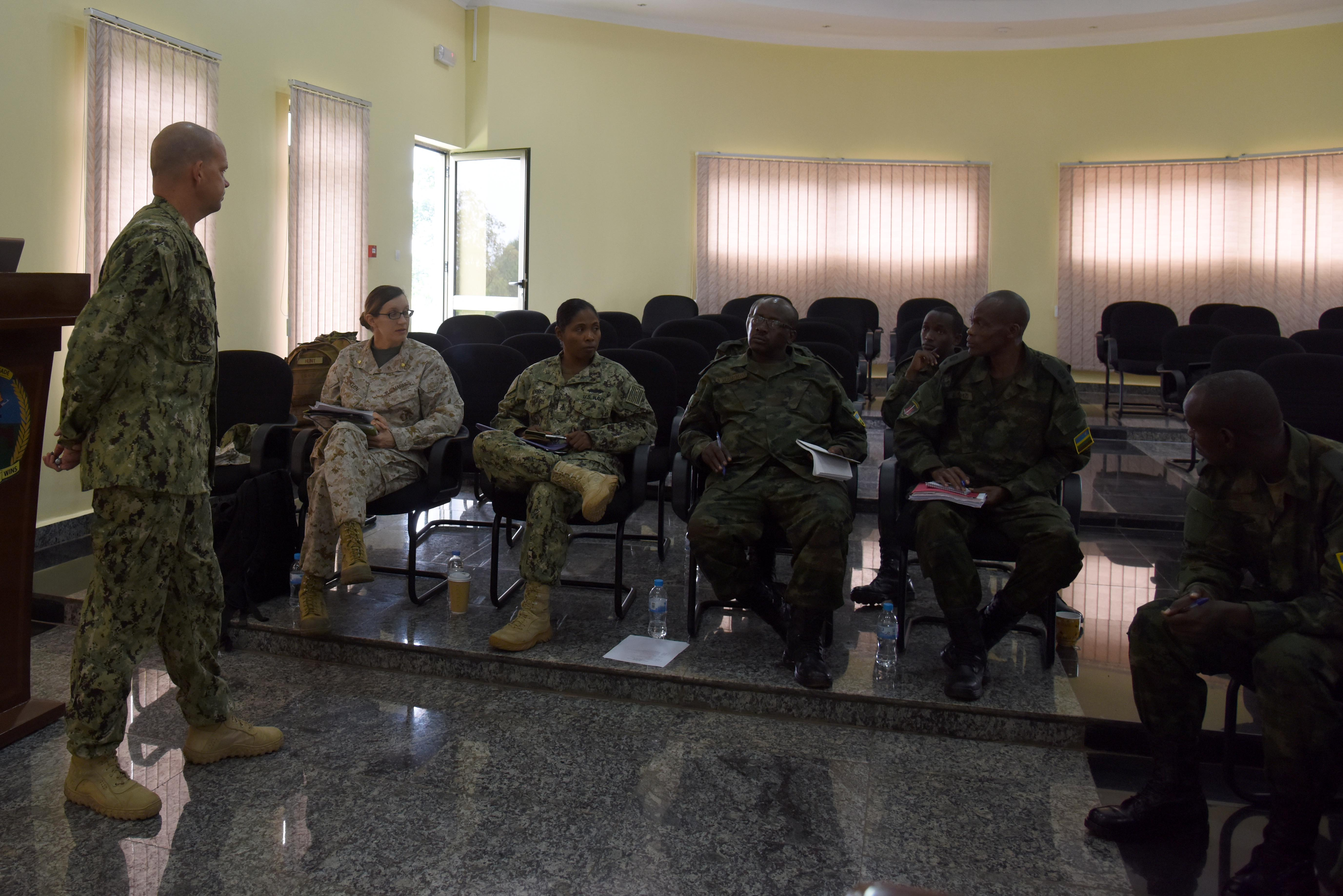 Engineers from Combined Joint Task Force-Horn of Africa and the Rwandan Defense Force exchange ideas on expeditionary camp planning at the RDF Engineering Brigade Headquarters near Kigali, Rwanda, Dec. 17, 2015. Both sides discussed approaches to support different types of operational units and missions in expeditionary environments. (U.S. Air Force photo by Staff Sgt. Victoria Sneed)