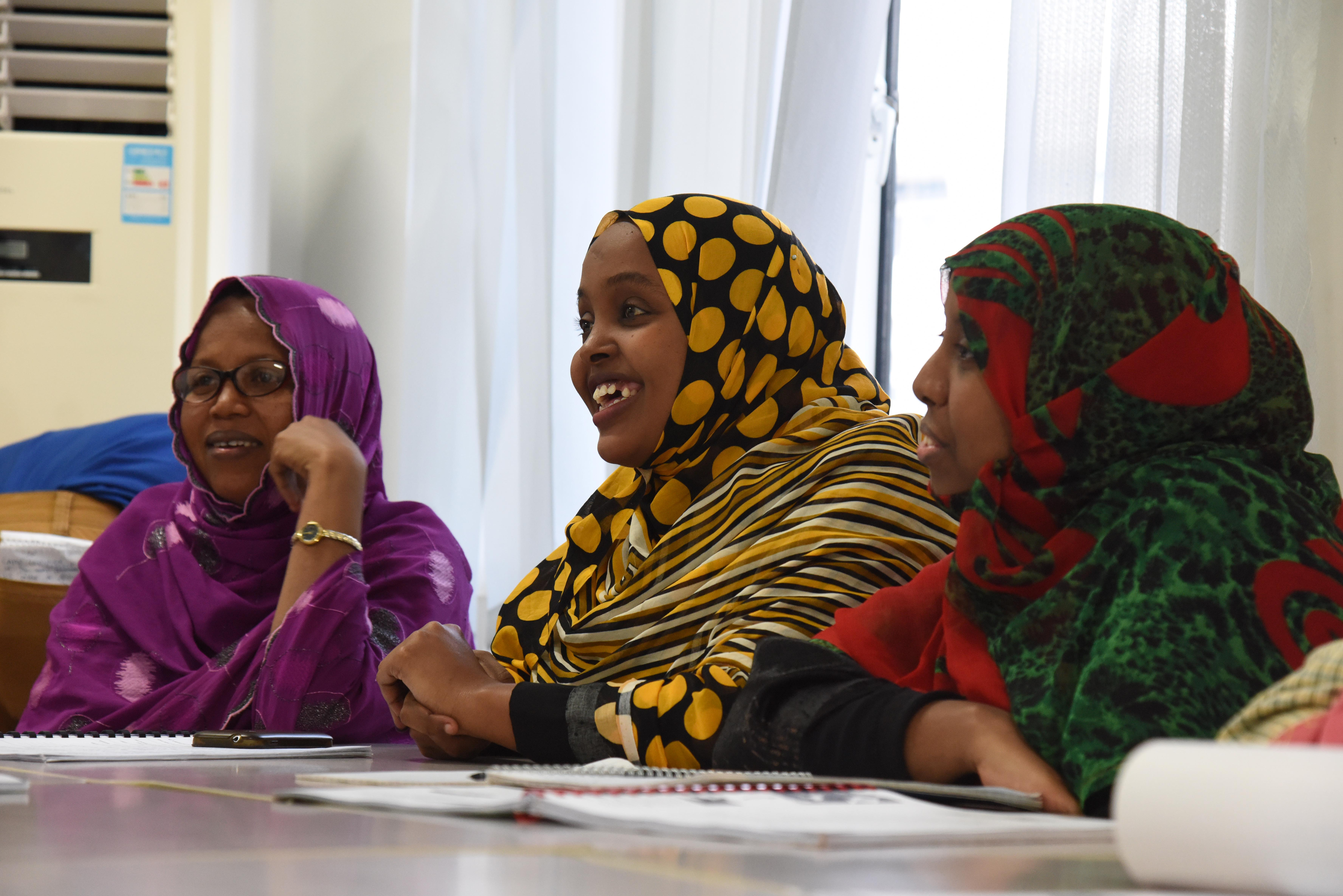 Djiboutian students laugh with U.S. military members during an English discussion group at the Diplomatic Institute in Djibouti, Jan. 12, 2016. More than 15 members from the local community participated in the group discussions, improving their English speaking and comprehension skills by interacting with native speakers. (U.S. Air Force photo by Staff Sgt. Victoria Sneed)