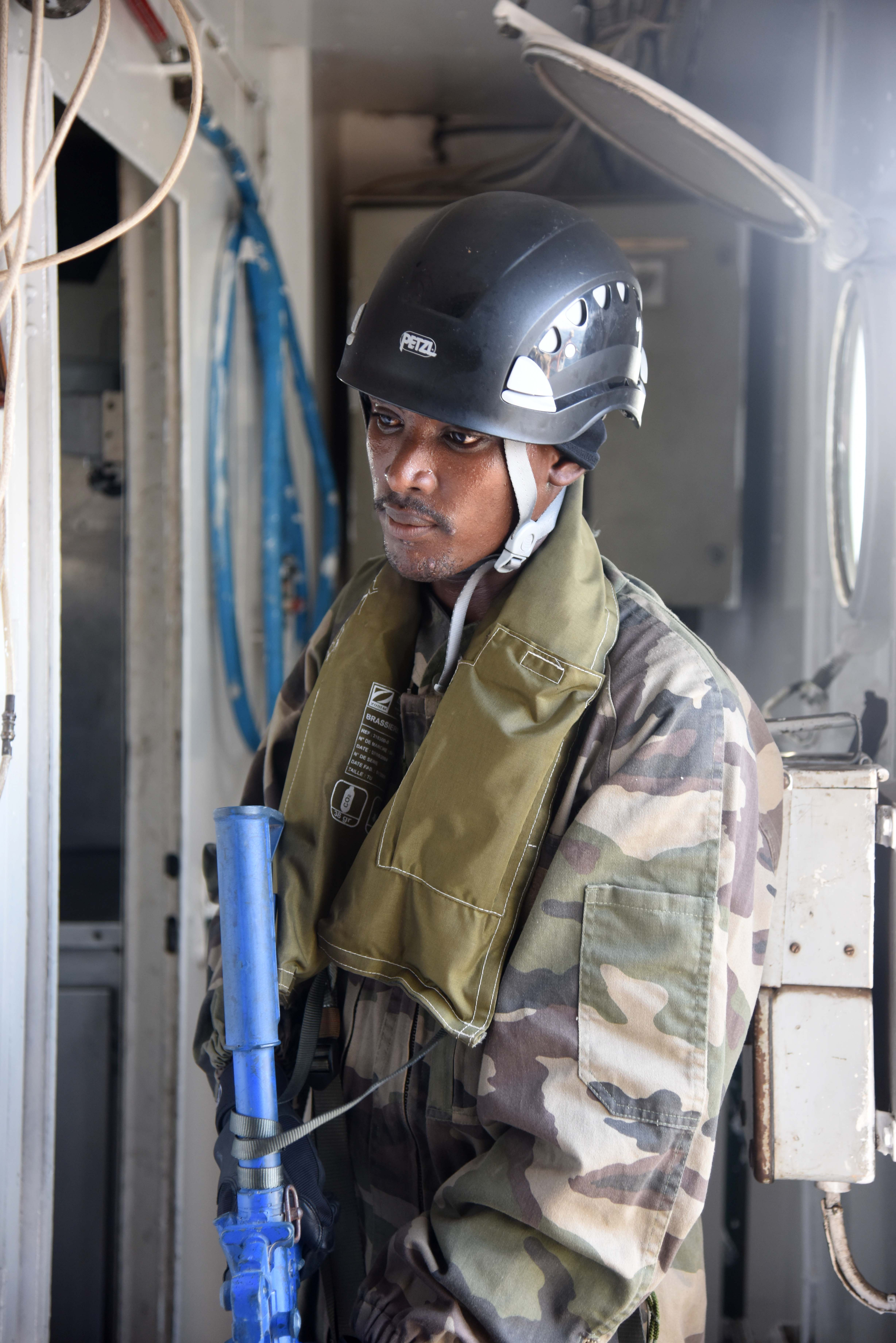 A Djibouti Marine searches a vessel suspected of illicit activity during a visit, board, search and seizure scenario as part of the 2016 Cutlass Express exercise near the Port of Djibouti, Feb. 3, 2016. The goal of the exercise was to strengthen regional cooperation and help address challenges that no single nation is capable of tackling alone.