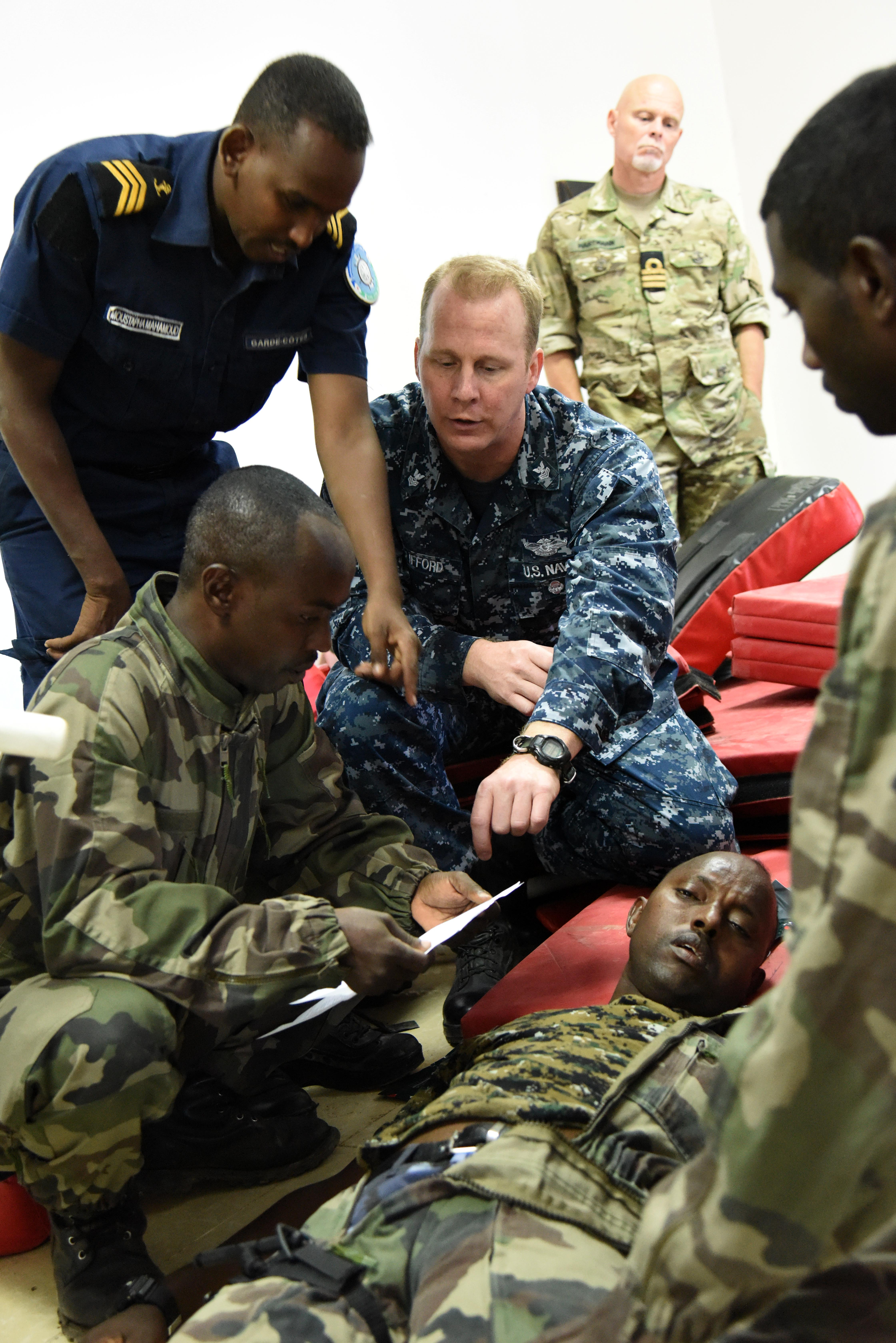 U.S. Navy Hospital Corpsman First Class Aaron Clifford, Cutlass Express medical instructor, explains how to treat a sucking chest wound on a simulated patient to Djibouti Coast Guardsmen and Marines during classroom instruction for exercise Cutlass Express Jan. 31, 2016, at the Djiboutian Coast Guard Academy, Djibouti. Exercise participants conducted a number of maritime security operations to include vessel queries, ship boarding, airborne maritime patrol operations, and search and rescue drills.