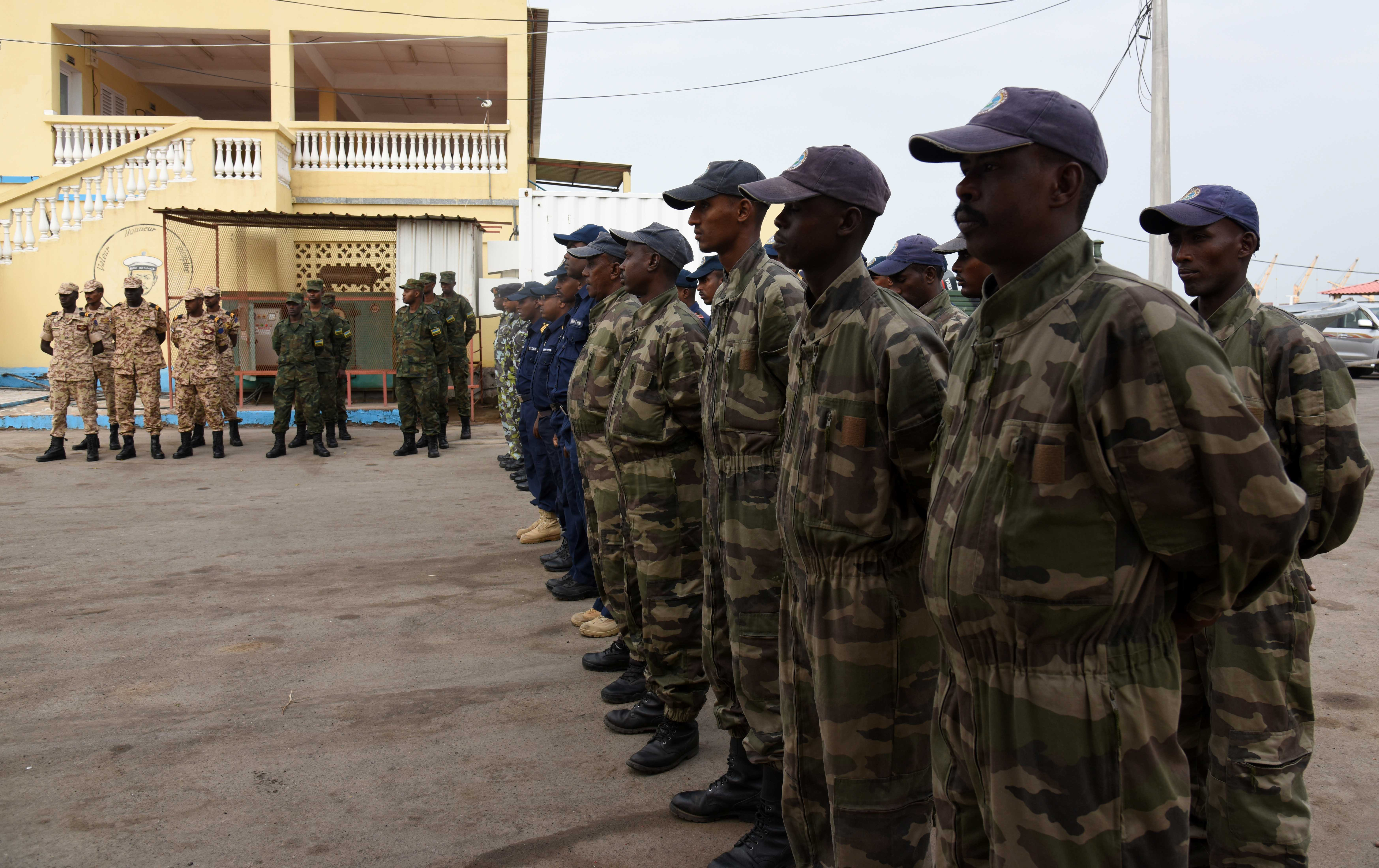 Participants from Sudan, Rwanda, Kenya, and Djibouti stand in formation during the opening ceremony of exercise Cutlass Express 2016 at the Djibouti Navy Base, Djibouti, Feb. 1, 2016. More than 450 personnel from 18 countries coordinated at two locations for the fifth iteration of the maritime exercise. (U.S. Air Force photo by Staff Sgt. Victoria Sneed)