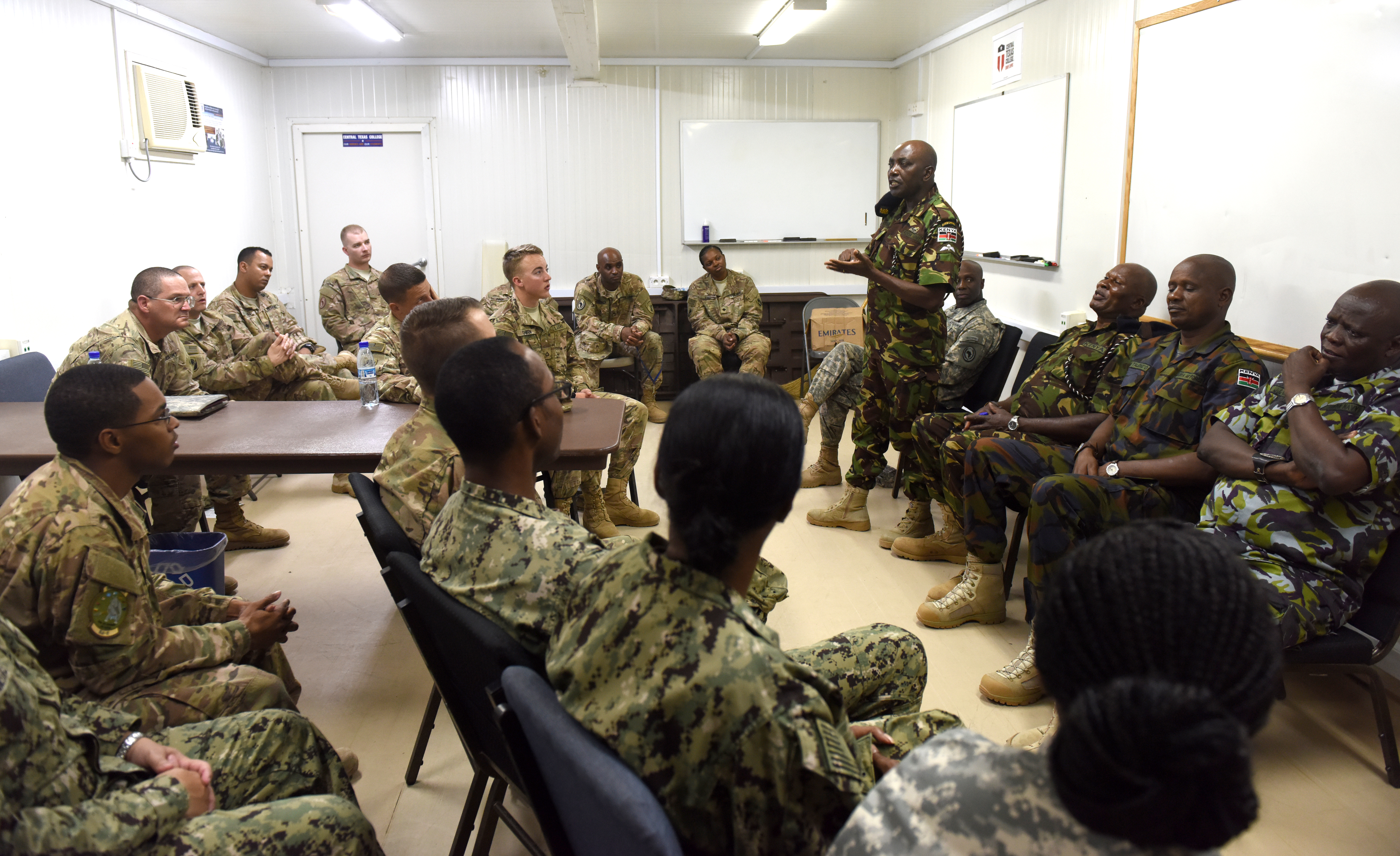 Senior enlisted leaders from the Kenya Defence Forces host a junior enlisted town hall meeting at Camp Lemonnier, Djibouti, during an SEL engagement Feb. 11, 2016. A difference amongst the KDF and U.S. enlisted forces is the level of responsibility and decision-making authority given to young Sailors, Soldiers, Airmen and Marines. (U.S. Air Force photo by Staff Sgt. Kate Thornton)