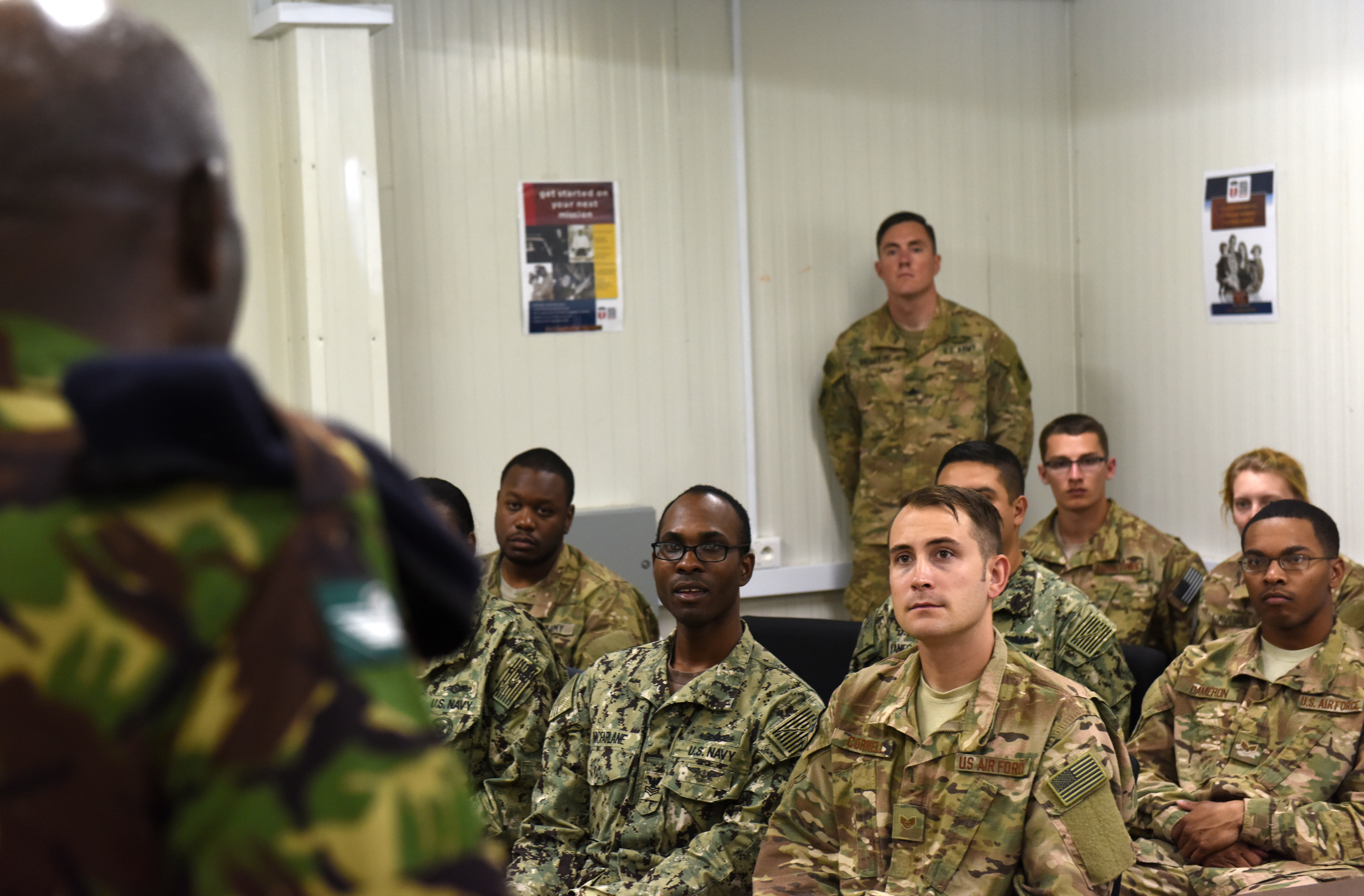 Warrant Officer John Muthoka, Kenya Defence Forces sergeant major, answers questions during a junior enlisted town hall meeting at Camp Lemonnier, Djibouti, as part of an SEL engagement Feb. 11, 2016. The four KDF SELs consisted of Muthoka and the ranking enlisted member of their army, air force and navy. (U.S. Air Force photo by Staff Sgt. Kate Thornton)