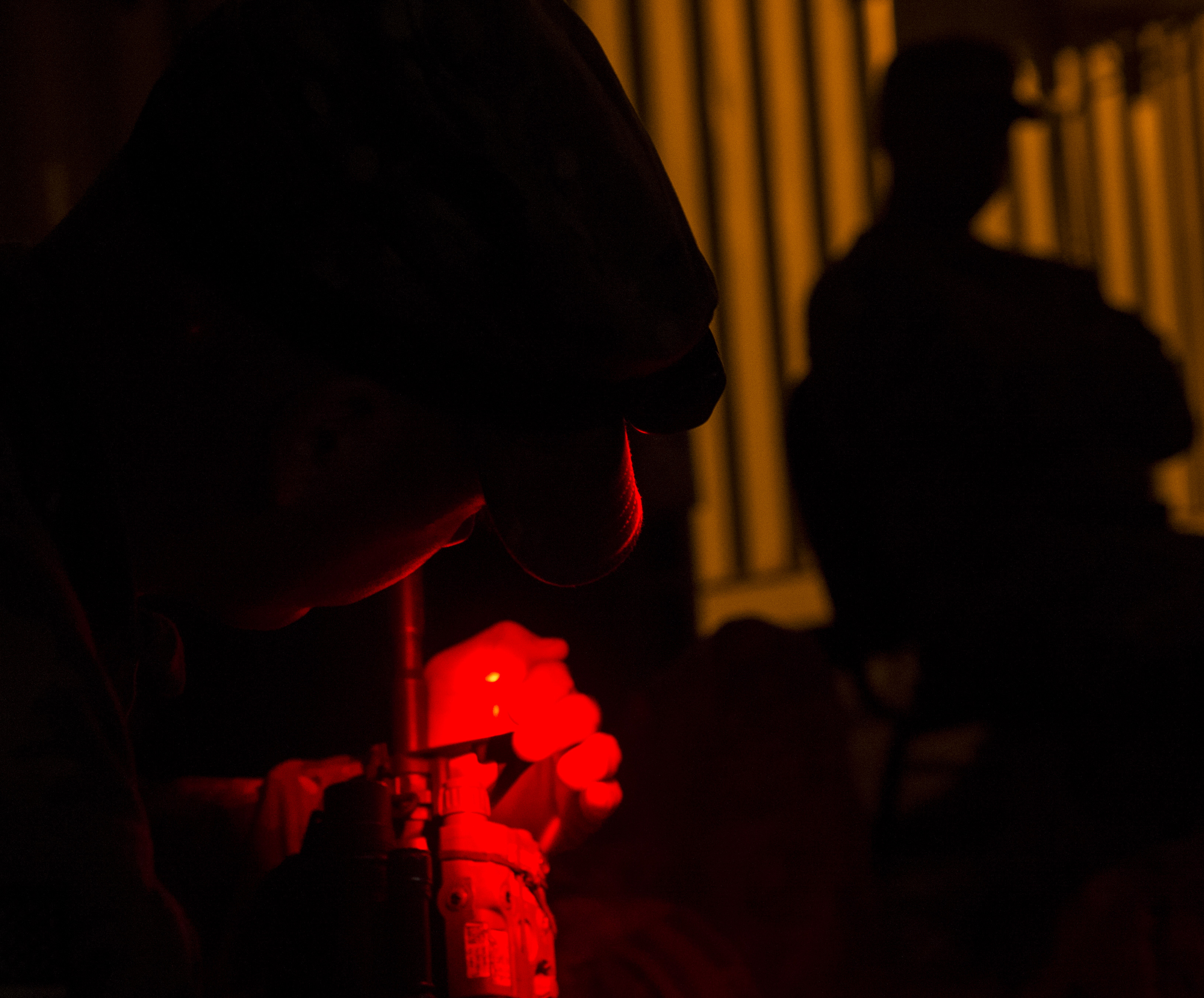 A U.S. Army Soldier from Bravo Company, 3rd Battalion, 15th Infantry Regiment, verifies his laser is properly functioning Feb. 13, 2016, at Camp Lemonnier, Djibouti. The East Africa Response Force serves as a part of U.S. Africa Command's crisis response capability, and is tasked with responding to emergency situations at U.S. Embassies in the East African region or in countries around the CJTF-HOA area of responsibility. (U.S. Air Force photo by Senior Airman Peter Thompson)