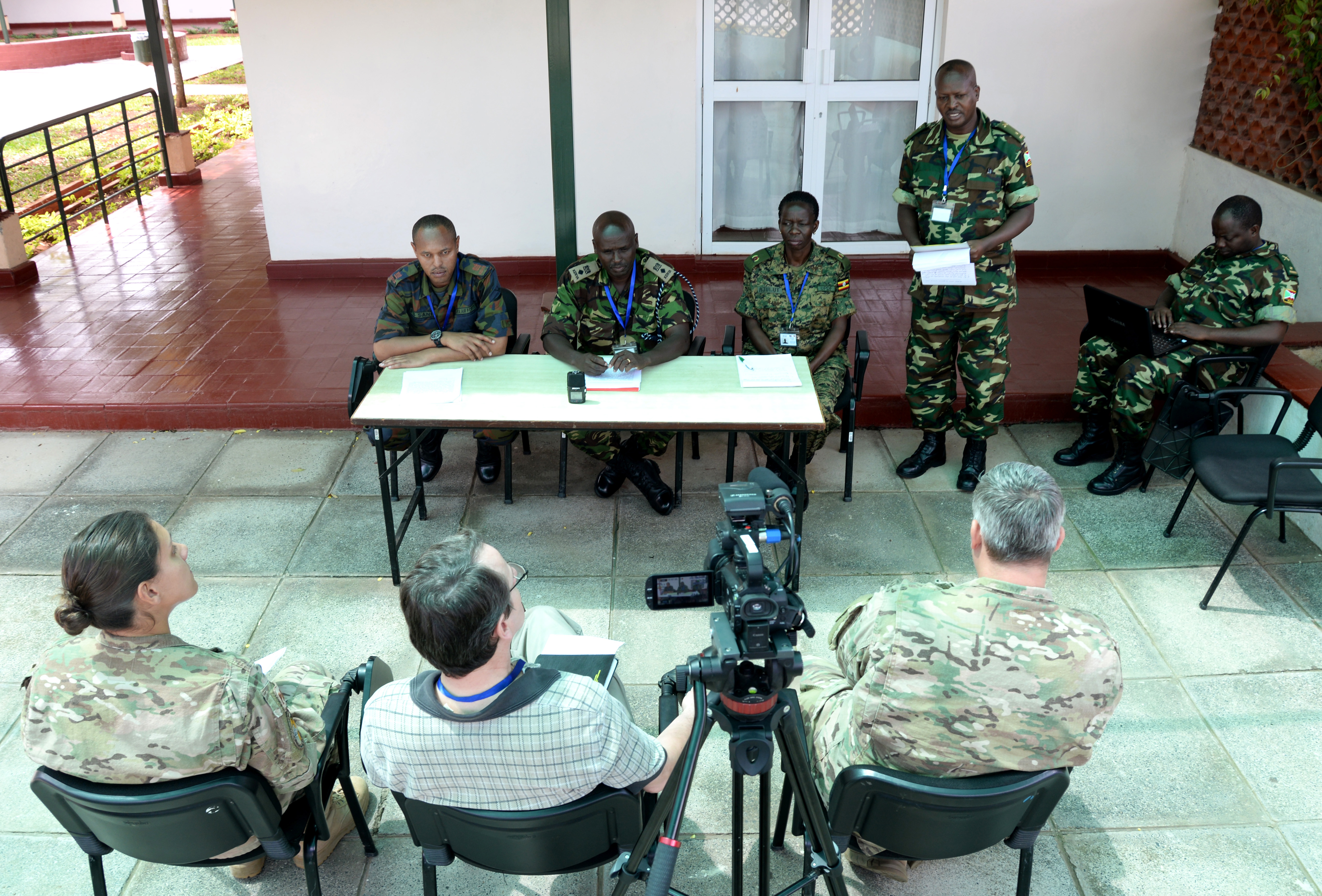 Officers from Kenya, Burundi and Uganda prepare for a simulated press conference March 3, 2016, during an exercise to complete an AMISOM staff officers course in Nairobi, Kenya.  The practice press conference tested the public information officers' ability to prepare the conference, media and staff. (U.S. Air Force photo by Staff Sgt. Kate Thornton)