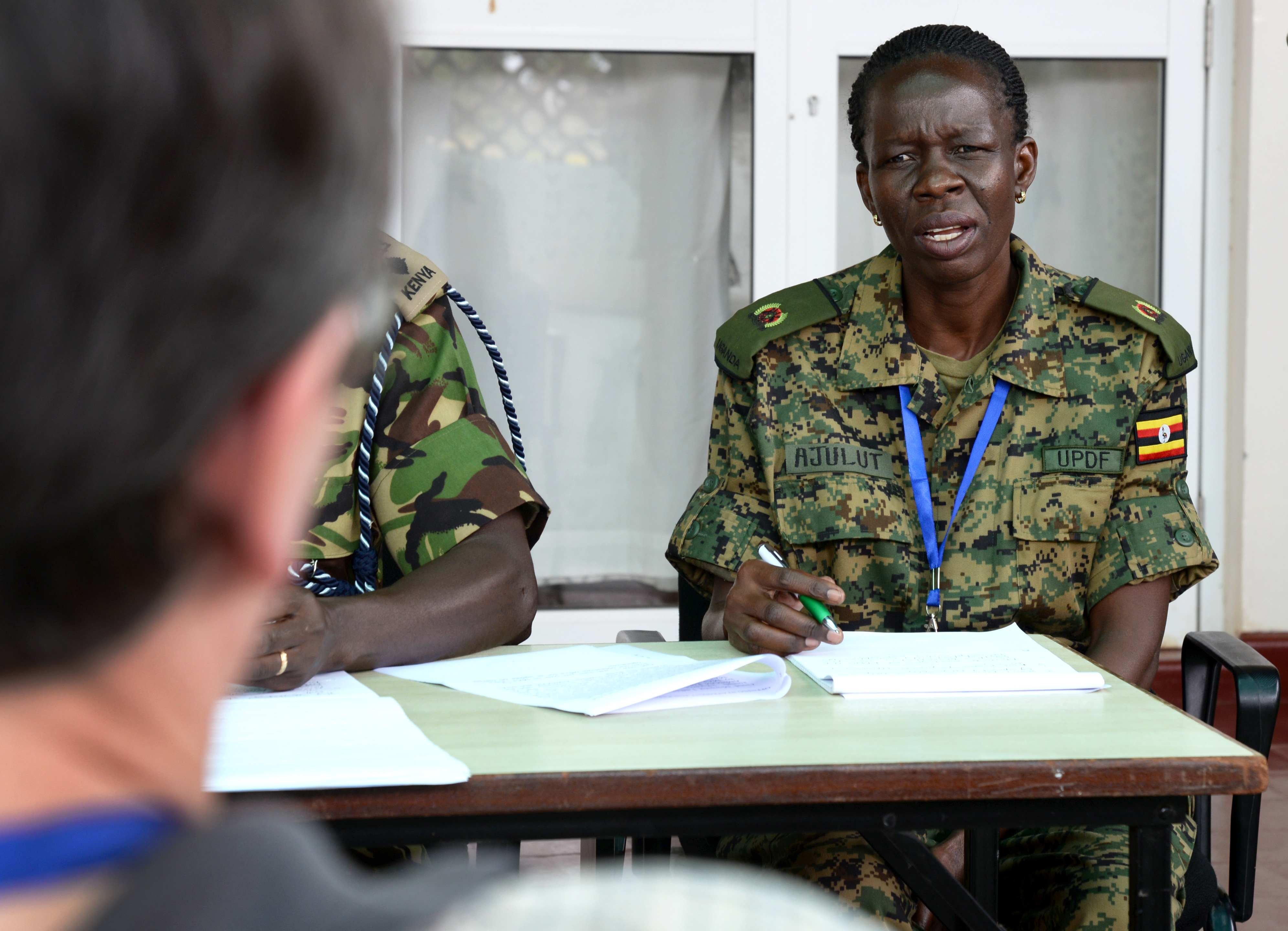 An officer from the Uganda People's Defence Force speaks to a media role player at a simulated press conference March 3, 2016, during an exercise to complete an AMISOM staff officers course in Nairobi, Kenya. The press conference tested the different directorate officers' ability to answer questions accurately, confidently and without revealing sensitive military information. (U.S. Air Force photo by Staff Sgt. Kate Thornton)