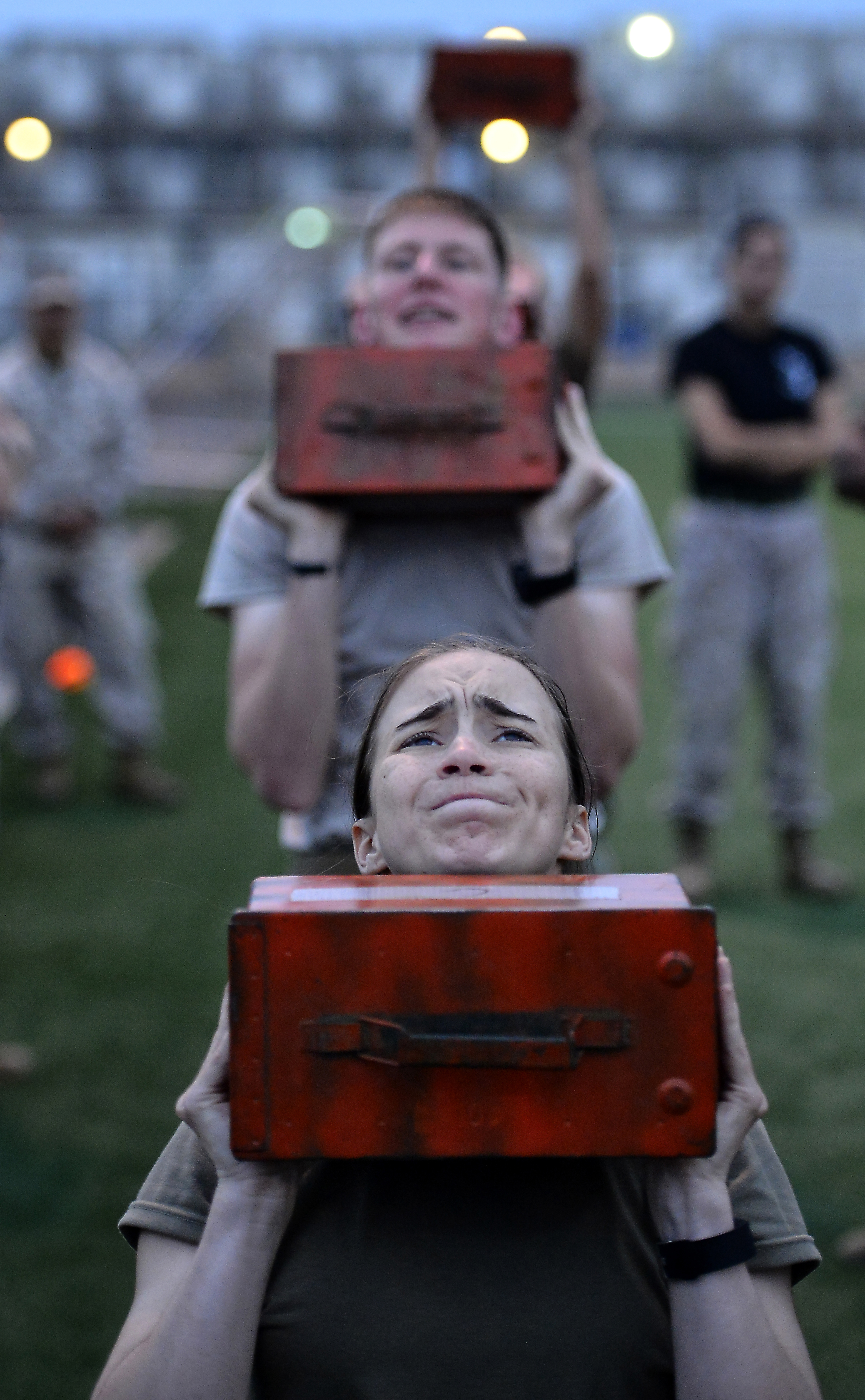 U.S. Army Spc. Jeileigh Bouchard, Joint Corporals Leadership Development Course student, lifts a weighted ammunition can during a combat fitness test March 8, 2016 at Camp Lemonnier, Djibouti. In addition to time spent in the classroom, students also participated in daily physical training sessions that included the Marine Corps physical training test and combat fitness test. (U.S. Air Force photo by Tech. Sgt. Dan DeCook)