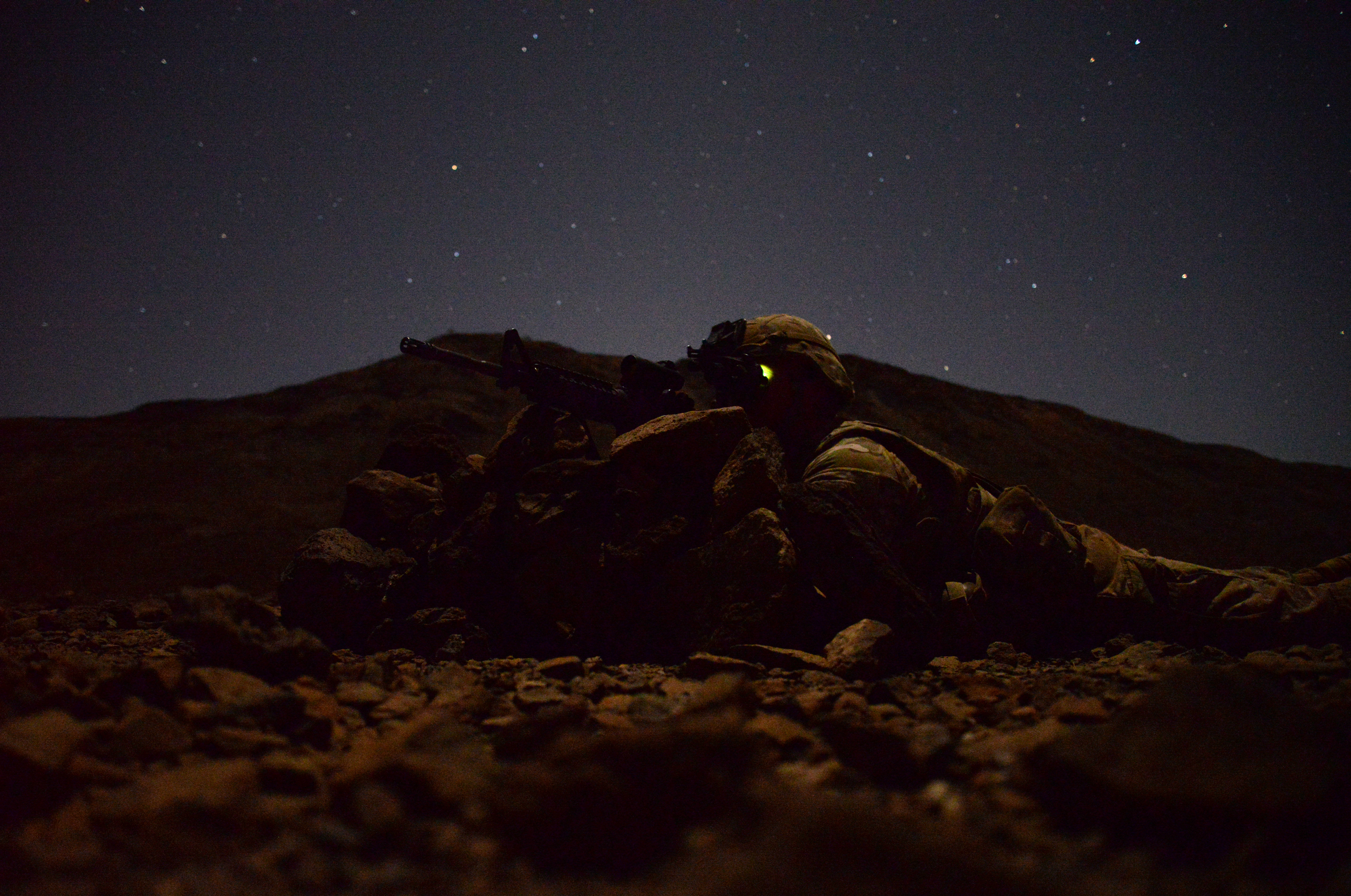 U.S. Army Spc. Micah Whitten, 2-124 Seminole Battalion infantry member, watches his area of responsibility during a field training exercise March 16, 2016, in Arta, Djibouti. The Soldiers received attacks throughout the night from simulated opposing forces, requiring the Soldiers to quickly take action to defend their post. (U.S. Air Force photo by Staff Sgt. Kate Thornton)