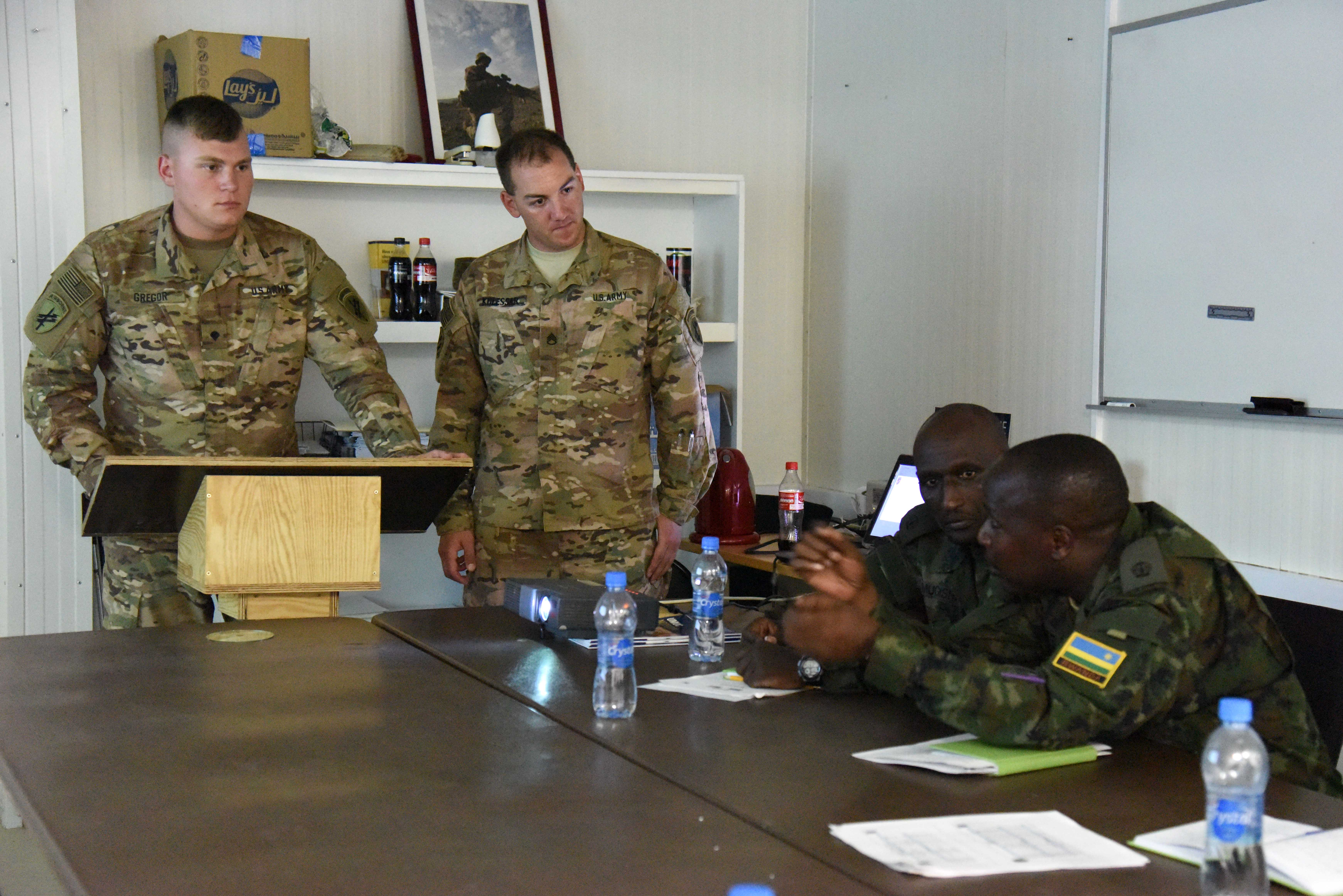 Members of the Rwanda Defence Force discuss use of interpreters with Soldiers from the 403rd Civil Affairs Battalion during a Civil-Military Cooperation engagement April 6, 2016, at Camp Lemonnier, Djibouti. The engagement was the second exchange of best practices to strengthen the relationship between CJTF-HOA and RDF to support regional training efforts for peacekeeping operations. (U.S. Air Force photo by Staff Sgt. Victoria Sneed)