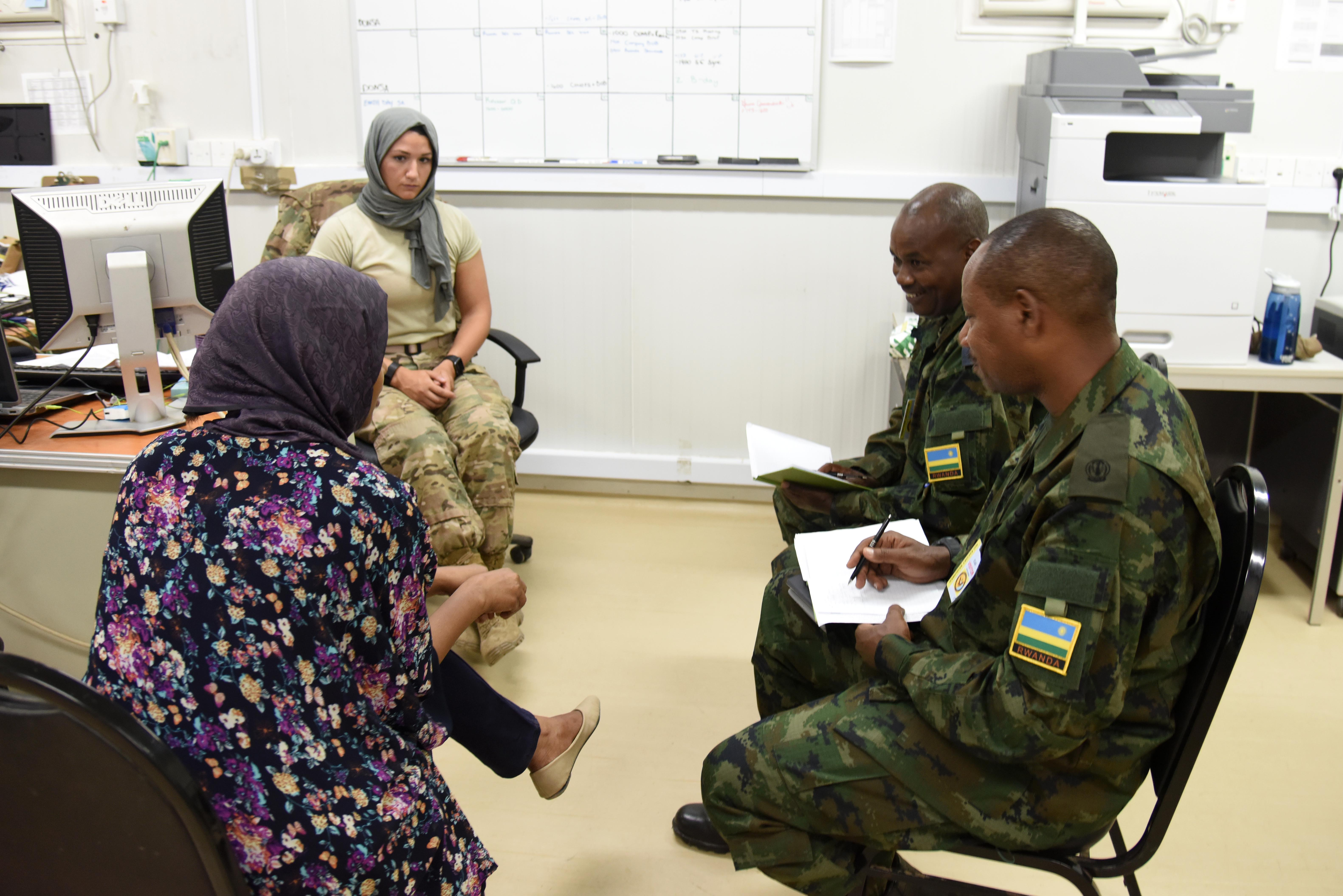 Rwanda Defence Force Civil-Military Affairs officers use an interpreter to gather information from a role player during a simulated needs assessment, April 7, 2016, at Camp Lemonnier, Djibouti. Both U.S. and Rwandan forces rely on interpreters to not only relay information, but also help with cultural understanding. (U.S. Air Force photo by Staff Sgt. Victoria Sneed)
