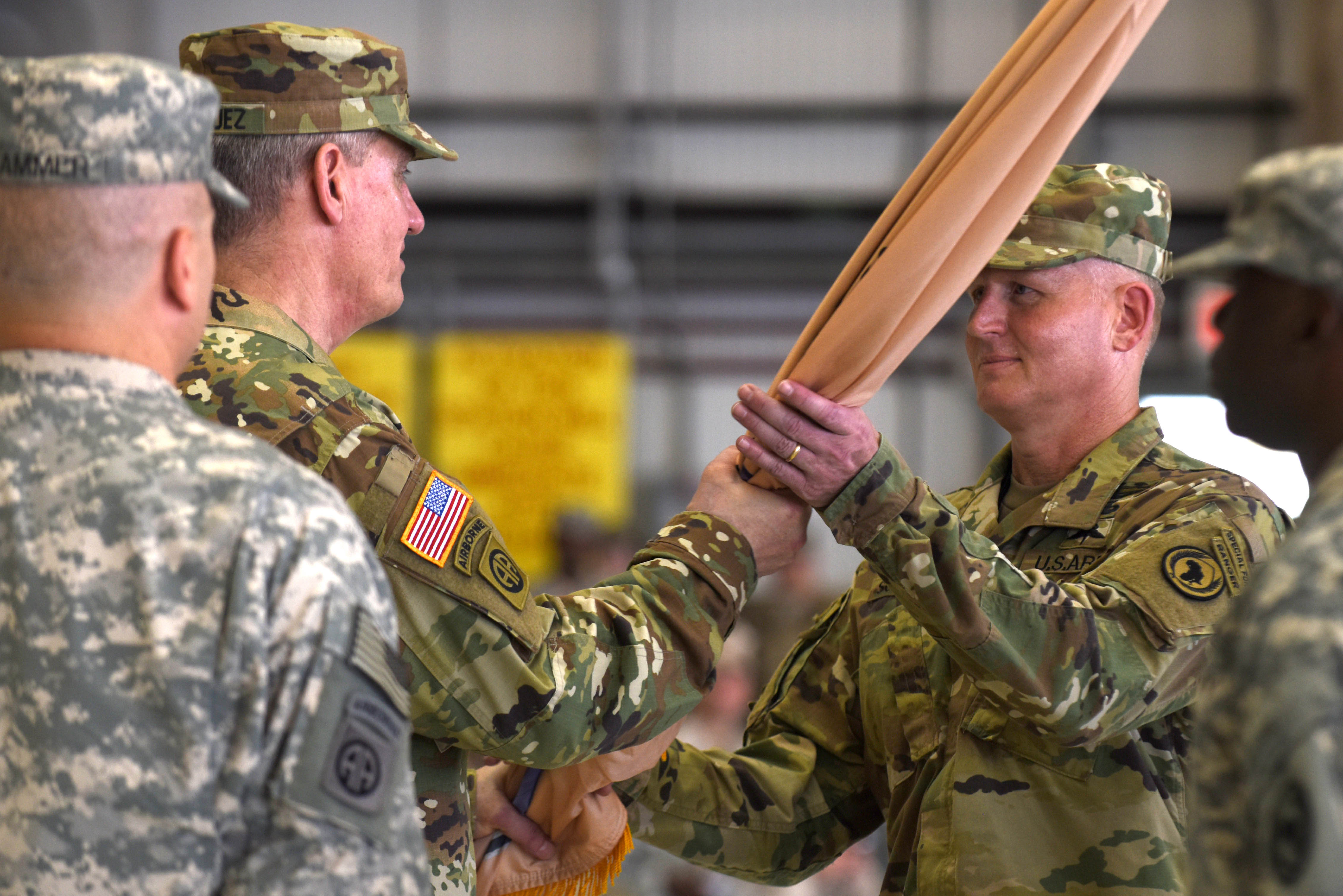 U.S. Army Gen. David M. Rodriguez, U.S. Africa Command commanding general, passes the Combined Joint Task Force-Horn of Africa flag to Brig. Gen. Kurt Sonntag during a change of command ceremony April 13, 2016, at Camp Lemonnier, Djibouti. The passing of the flag signified the change of command from Maj. Gen. Mark Stammer to Sonntag, as the CJTF-HOA commanding general. (U.S. Air Force photo by Staff Sgt. Kate Thornton)