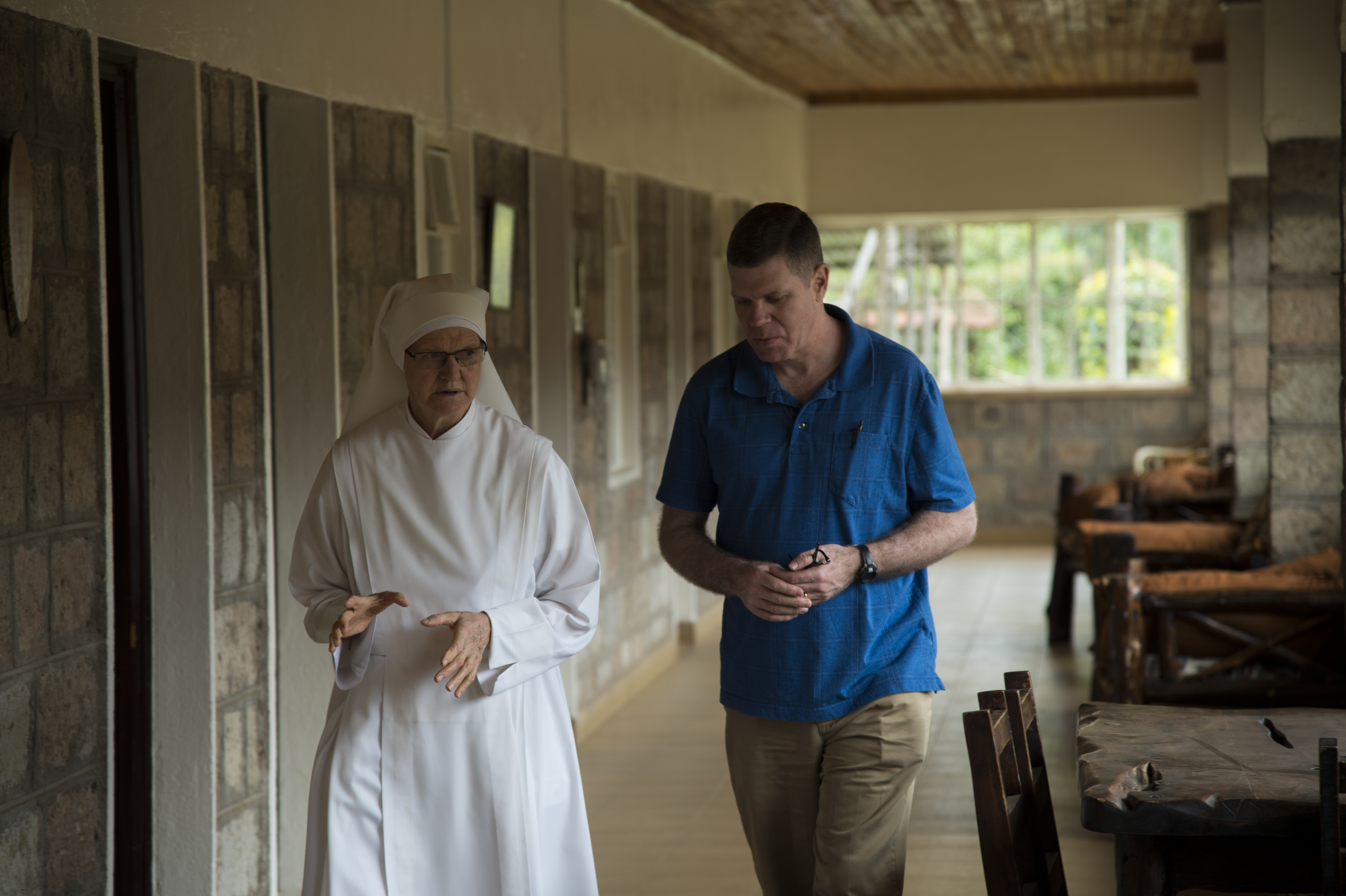 Sister Helen Creed and U.S. Navy Chaplain Capt. Travis Moger, Combined Joint Task Force-Horn of Africa office of religious affairs director, talk about the elderly care facilities and services they provide to the residents May 9, 2016, in Nairobi, Kenya. Nyumba Ya Wazee, or Home of the Elderly, provides shelter and care for 68 residents. (U.S. Air Force photo by Staff Sgt. Eric Summers Jr.)