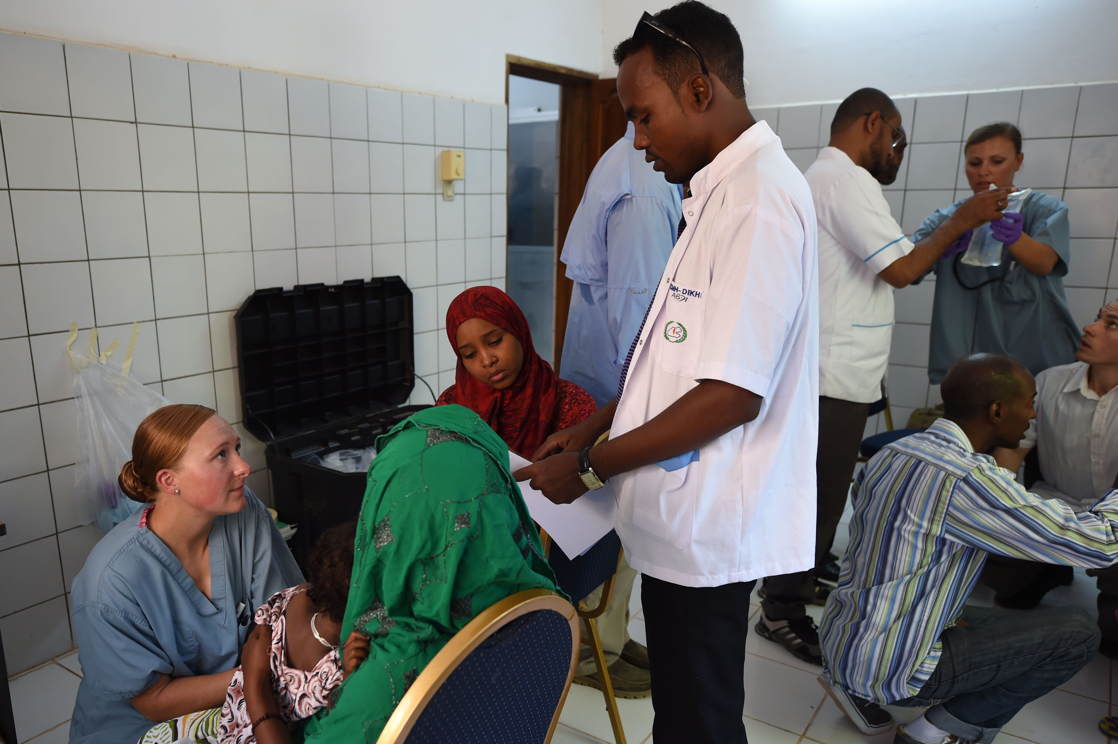 DIKHIL, Djibouti – Soldiers from the 403rd Civil Affairs Battalion work with Djibouti Ministry of Health, Cuban medical personnel and translators to provide treatment to the people during a medical civic action program at Dikhil, Djibouti, May 11, 2016. The medical team spent 10 hours together treating around 140 people while comparing and exchanging medical knowledge for the illnesses prominent in the region. (U.S. Air Force photo by Staff Sgt. Tiffany DeNault)