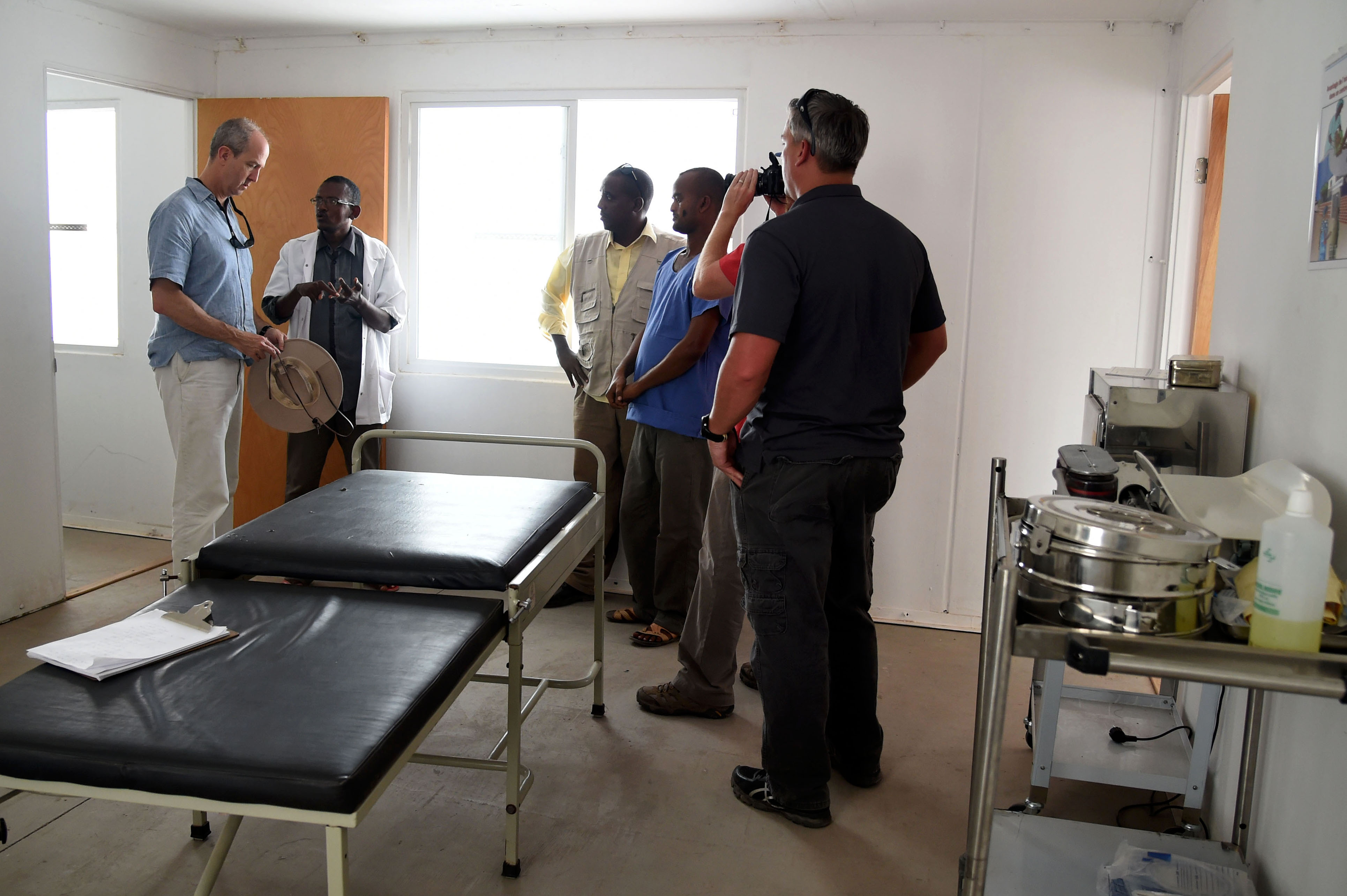 KALAF, Djibouti –  Ambassador Tom Kelly, U.S. Ambassador to the Republic of Djibouti visits with Djiboutian medical personnel at Kalaf Medical Clinic in Kalaf, Djibouti, May 17, 2016. Completed by Naval Mobile Construction Battalions 133 and 74, the clinic is the first in its area providing primary medical care to Kalaf, Tadjoura and surrounding villages. (U.S. Air Force photo by Staff Sgt. Tiffany DeNault)