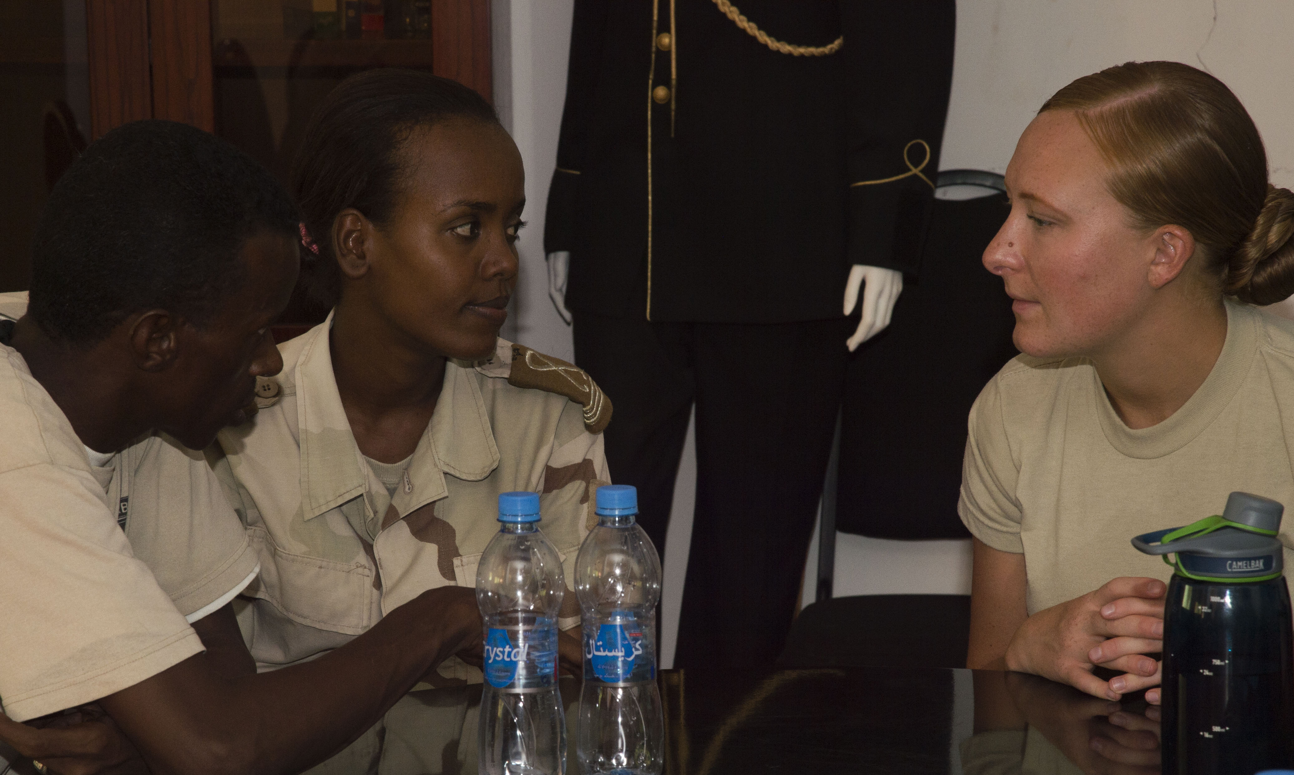 Cadet Ali, Djibouti's Arta Interservices Military Academy third-year student, attempts to negotiate with U.S. Army Spc. Kristie Richardson, 403rd Civil Affairs and scenario role player, during Civil Military Cooperation training May 18, 2016, at Arta, Djibouti.  The course was intended to teach the cadets communication and interaction skills with host nation civilians, and for them to pass the information to other soldiers after they graduate and are assigned to units. (U.S. Air Force photo by Staff Sgt. Eric Summers Jr.)