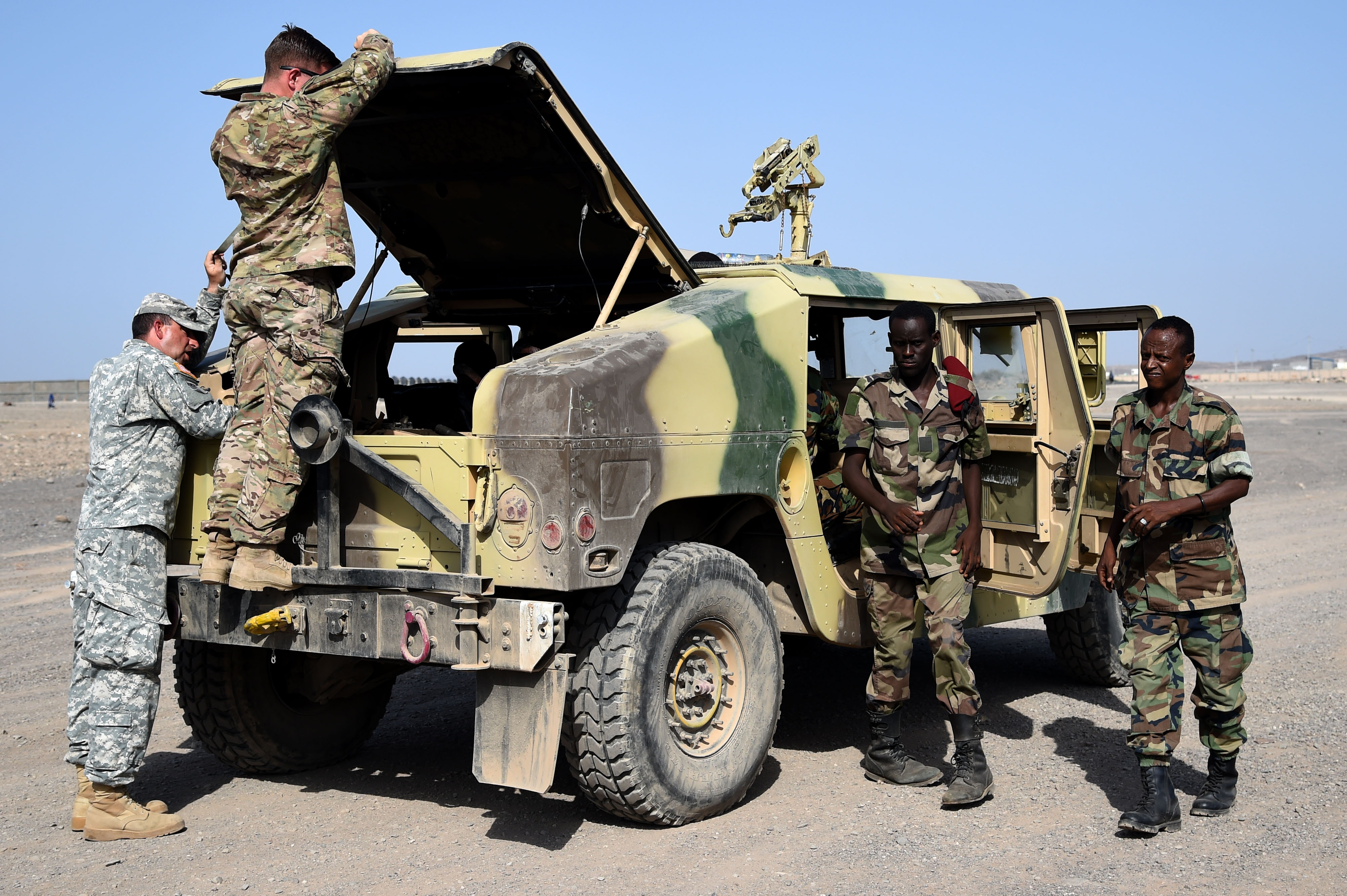 CAMP CHEIK OSMAN, Djibouti – Djiboutian Armed Forces (FAD) Soldiers prepare their Humvee for the final test after completing a five-month training course instructed by the U.S. Army Regionally Aligned Forces Soldiers, May 16, 2016, at Camp Cheik Osman, Djibouti. The FAD soldiers tested the skills they learned by demonstrating their reactions to various mock situations from convoying through a road block, identifying mock roadside bombs, medical care, and vehicle recovery. (U.S. Air Force photo by Staff Sgt. Tiffany DeNault)