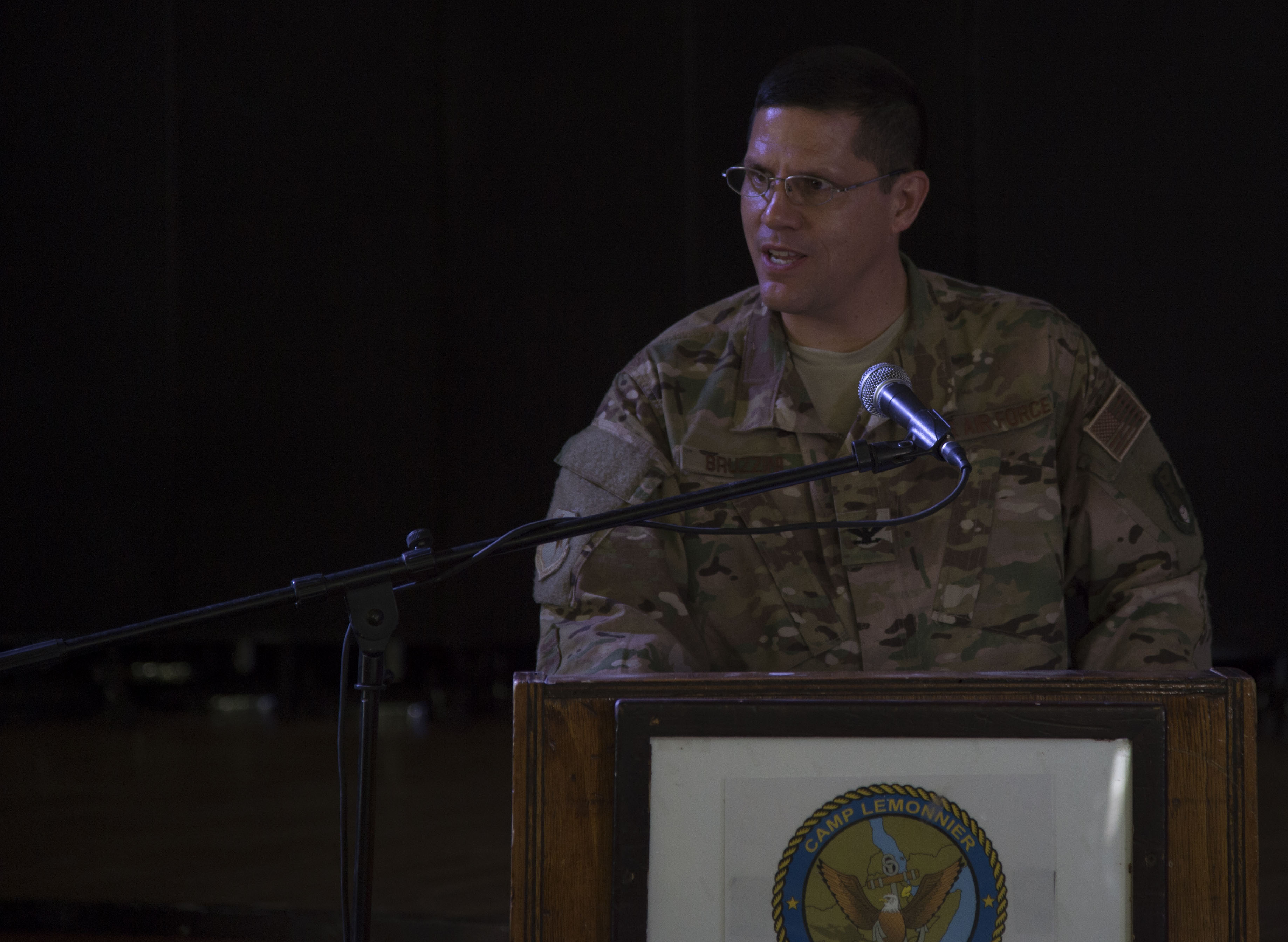 U.S. Air Force Col. Michael Bruzzini, 449th Air Expeditionary Group incoming commander, makes his first remarks to his new unit during the 449th AEG Change of Command ceremony June 6, 2016, at Camp Lemonnier, Djibouti. Bruzzini comes to the 449th AEG from the Office of the Assistant Secretary of the Air Force for Financial Management and Comptroller, where he served as the deputy assistant secretary for programs. (U.S. Air Force photo by Staff Sgt. Eric Summers Jr.)