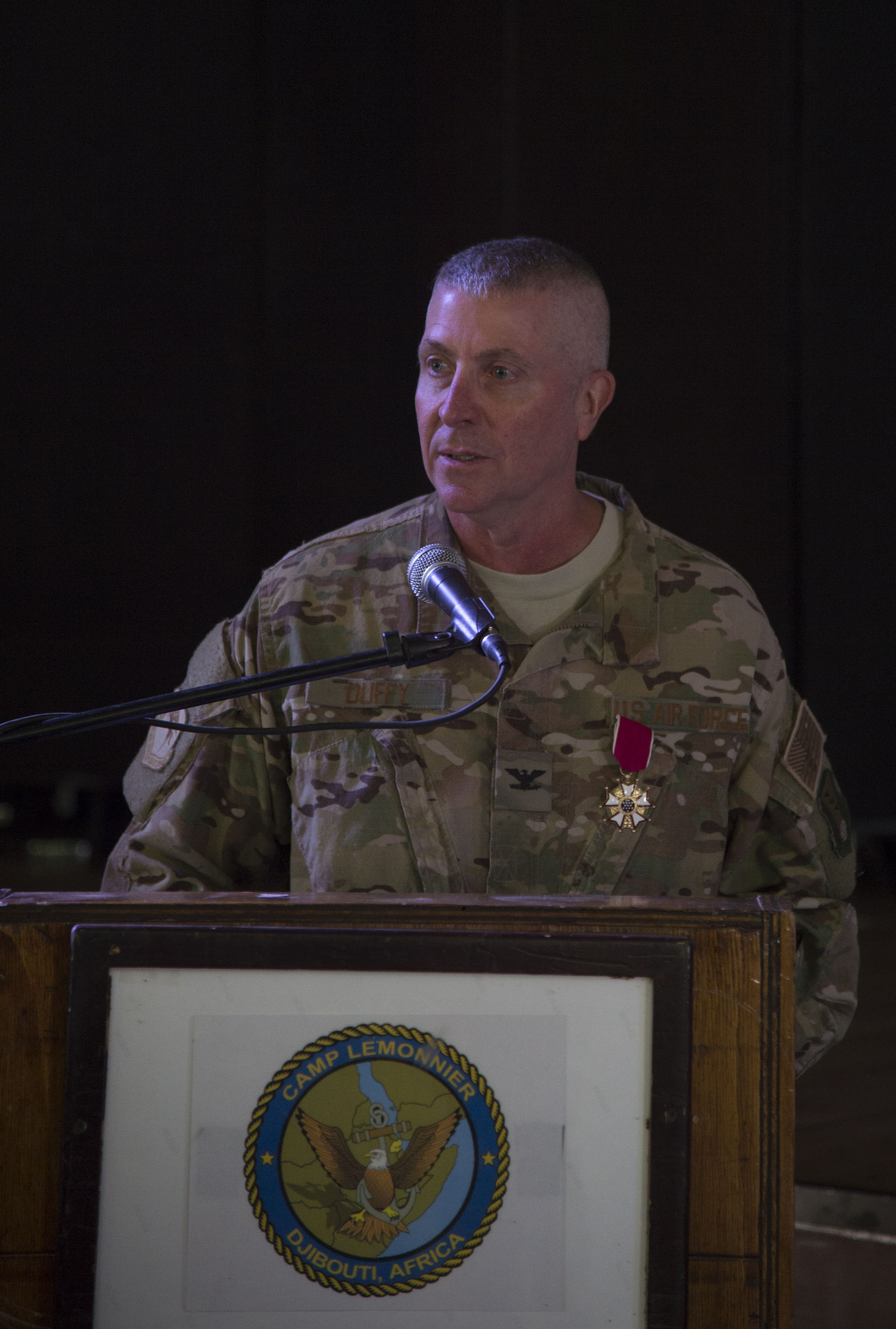 U.S. Air Force Col. Daniel Duffy, 449th Air Expeditionary Group outgoing commander, makes final remarks to the men and women of the group during the 449th AEG Change of Command ceremony June 6, 2016, at Camp Lemonnier, Djibouti. The 449th AEG is assigned to U.S. Air Forces Africa and conducts personnel recovery and other operations in support of activities for Air Forces Africa and Combined Joint Task Force-Horn of Africa. (U.S. Air Force photo by Staff Sgt. Eric Summers Jr.)