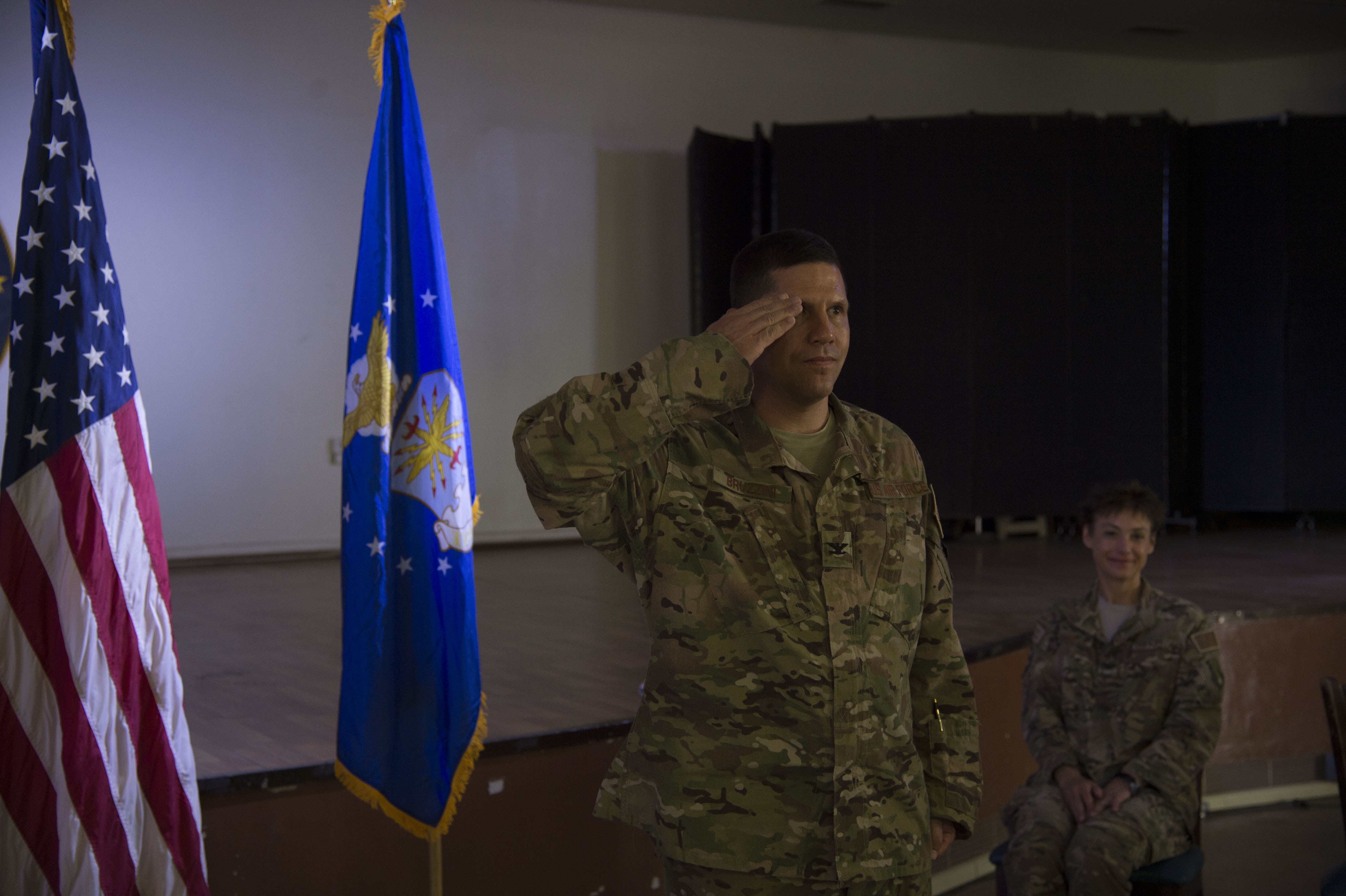 U.S. Air Force Col. Michael Bruzzini, 449th Air Expeditionary Group incoming commander, presents his first salute to the unit during the 449th AEG Change of Command ceremony June 6, 2016, at Camp Lemonnier, Djibouti. Bruzzini has experience in combat and combat support missions in Operations Allied Force, Southern Watch, Iraqi Freedom and Enduring Freedom, as well as experience in the Horn of Africa. (U.S. Air Force photo by Staff Sgt. Eric Summers Jr.)