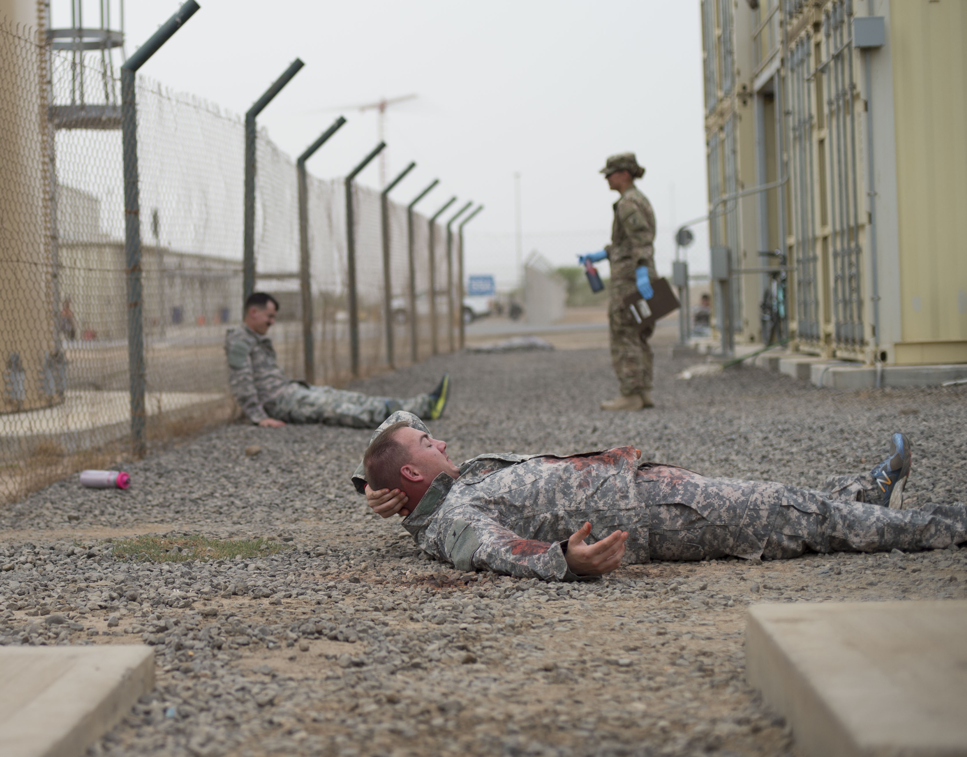 Simulated casualties lay on the ground before receiving treatment during a combat lifesaver course June 23, 2016, at Camp Lemonnier, Djibouti. The course taught the students basic skills that could potentially save lives on a battlefield. (U.S. Air Force photo by Staff Sgt. Eric Summers Jr.)