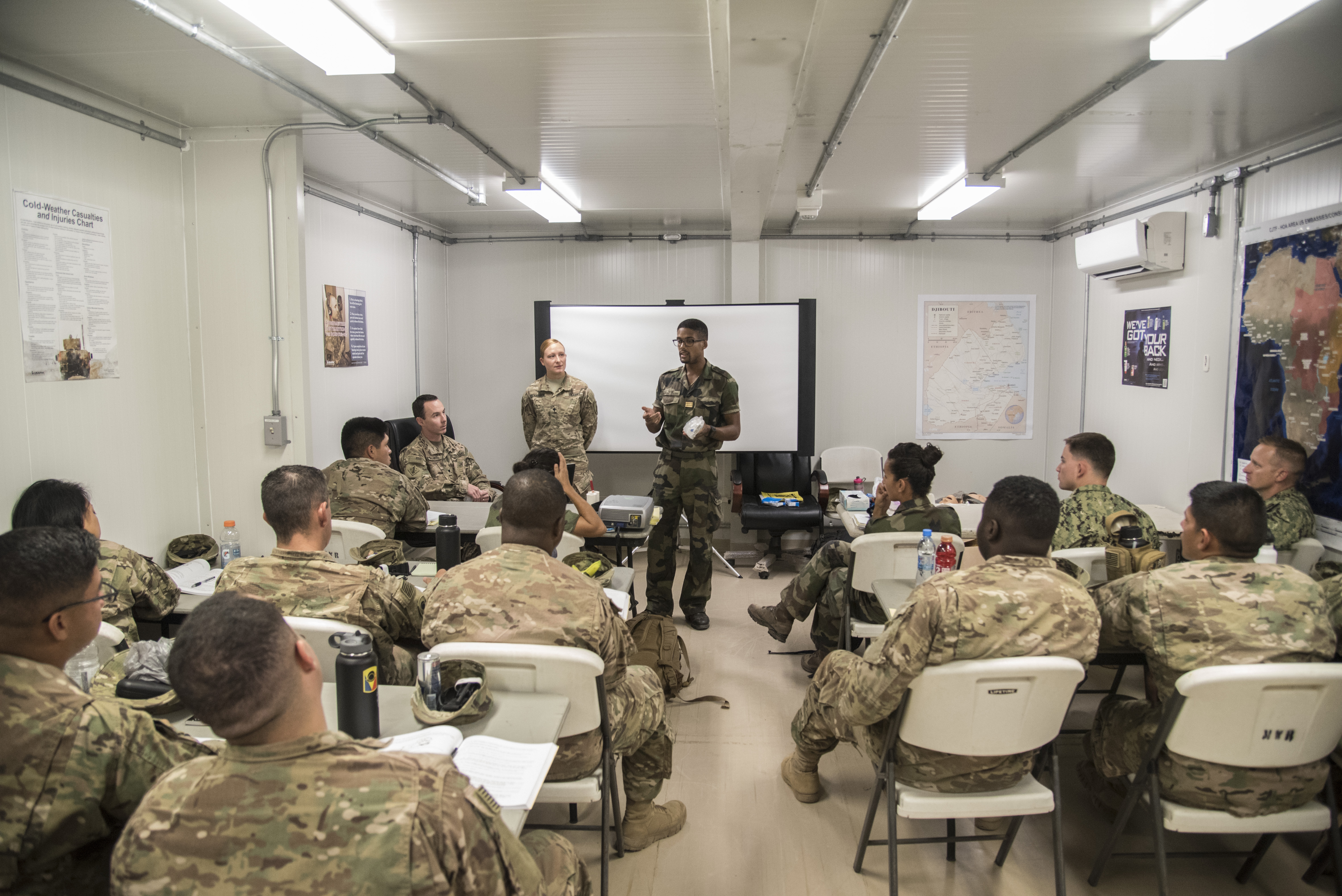 CAMP LEMONNIER, Djibouti- French Capt. Xavier, physician, demonstrates the French medical supplies and how they are used during a combat lifesaver course, June 21, 2016, at Camp Lemonnier, Djibouti. Taught by soldiers from the 403rd Civil Affairs Battalion assigned to Combined Joint Task Force-Horn of Africa, this four day CLS course was the first to have French service members attend to learn and share medical skillsets. (U.S. Air Force photo by Staff Sgt. Tiffany DeNault)