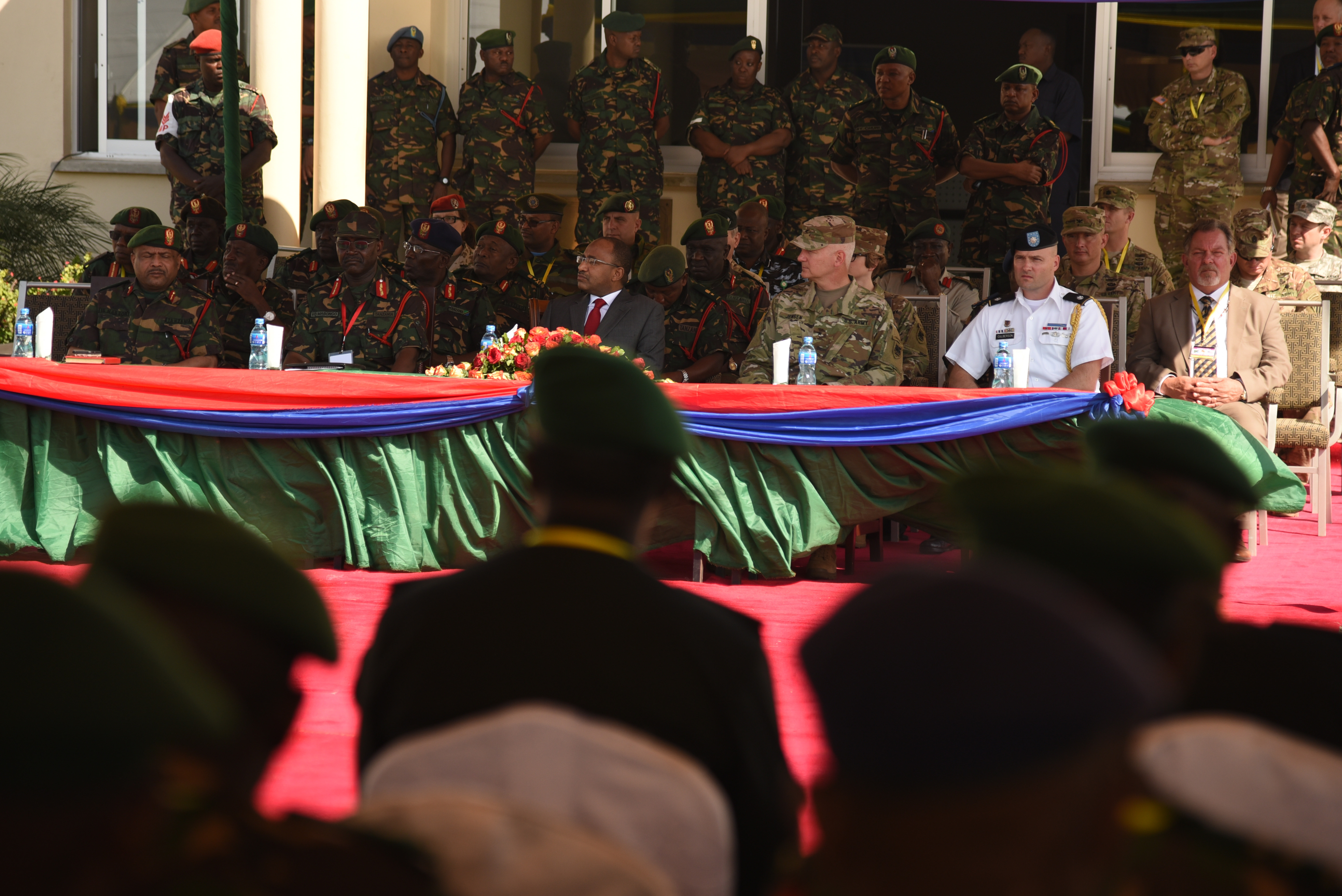 DAR ES SALAAM, Tanzania – Senior military leaders from the Tanzanian and U.S. militaries, alongside Hussein Ali Mwinyi, Tanzanian Minister of Defense and National Service, preside over the opening ceremony for exercise Eastern Accord 2016 at the Tanzanian Peacekeeping Training Centre, July 11, 2016, Dar es Salaam, Tanzania. EA16 is an annual, combined, joint military exercise that brings together partner nations to practice and demonstrate proficiency in conducting peacekeeping operations. (U.S. Air Force photo by Staff Sgt. Tiffany DeNault)