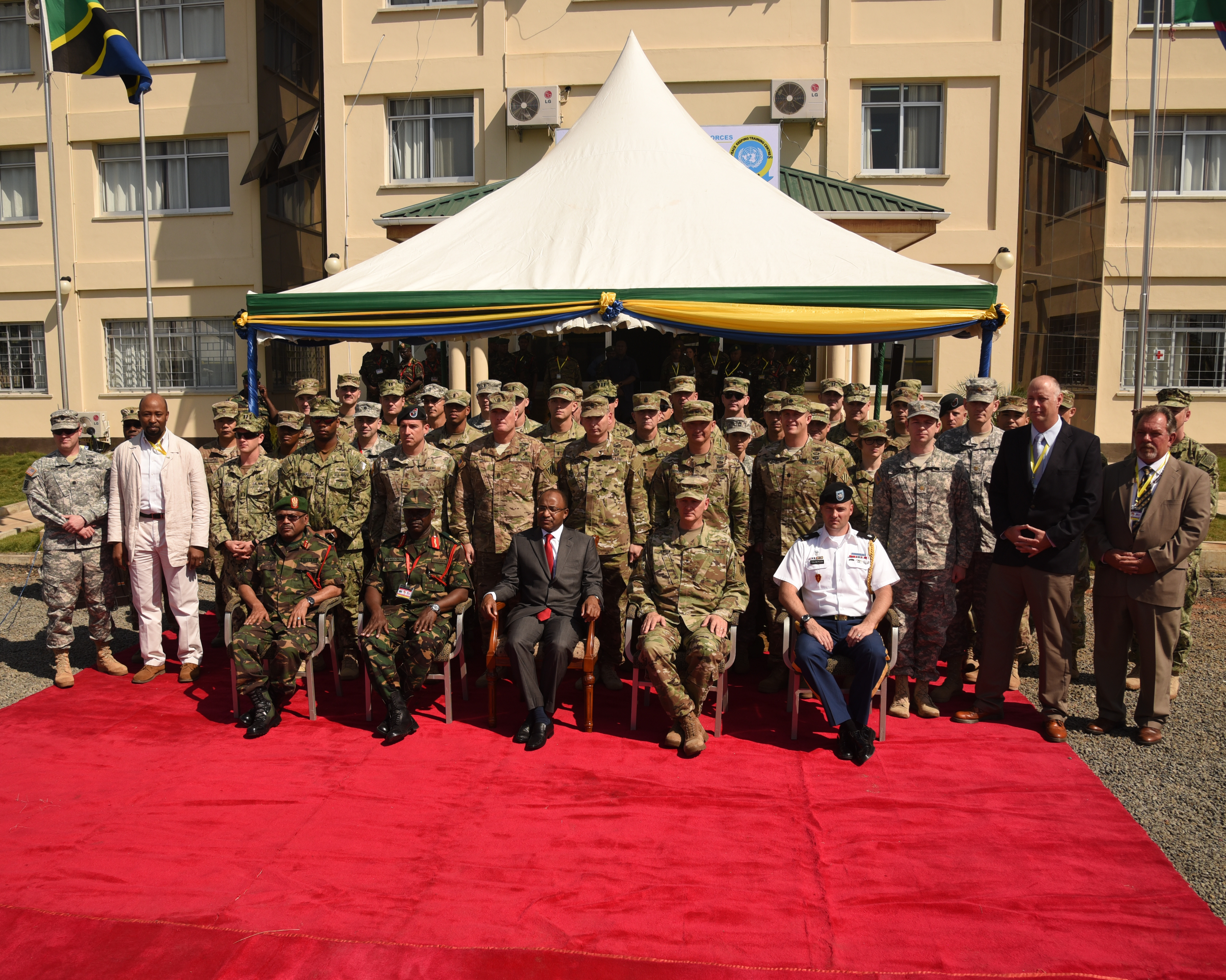 DAR ES SALAAM, Tanzania – Senior military leaders and Hussein Ali Mwyini, Minister of Defense and National Service, take a group photograph with the U.S. Eastern Accord 2016 participants at the Opening Ceremony at the Tanzanian Peacekeeping Training Centre on July 11, 2016, in Dar es Salaam, Tanzania. EA16 is an annual, combined, joint military exercise that brings together partner nations to practice and demonstrate proficiency in conducting peacekeeping operations. (U.S. Air Force photo by Staff Sgt. Tiffany DeNault)