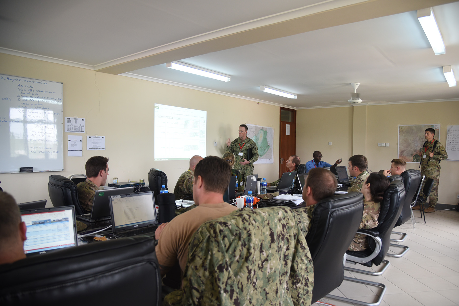 DAR ES SALAAM, Tanzania – Eastern Accord 2016 master scenario events list script writers review exercise injects for the command post exercise at the Tanzanian Peacekeeping Training Centre, July 16, 2016, in Dar es Salaam, Tanzania. EA16 is an annual, combined, joint military exercise that brings together partner nations to practice and demonstrate proficiency in conducting peacekeeping operations. (U.S. Air Force photo by Staff Sgt. Tiffany DeNault)