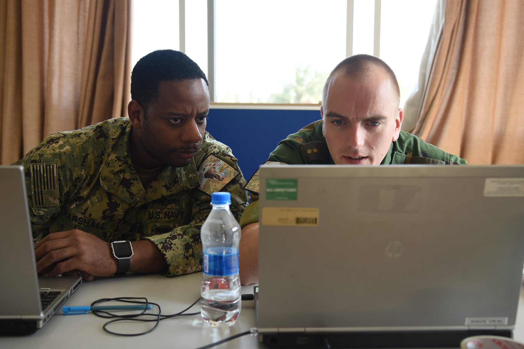 DAR ES SALAAM, Tanzania – U.S. Navy Petty Officer 1st Class Jaimee Marshall and Dutch Lt. Rene Kleijer, Eastern Accord 2016 participants, complete tasks for the first day of the command post exercise at the Tanzanian Peacekeeping Training Centre, July 19, 2016, in Dar es Salaam, Tanzania. EA16 is an annual, combined, joint military exercise that brings together partner nations to practice and demonstrate proficiency in conducting peacekeeping operations. (U.S. Air Force photo by Staff Sgt. Tiffany DeNault)