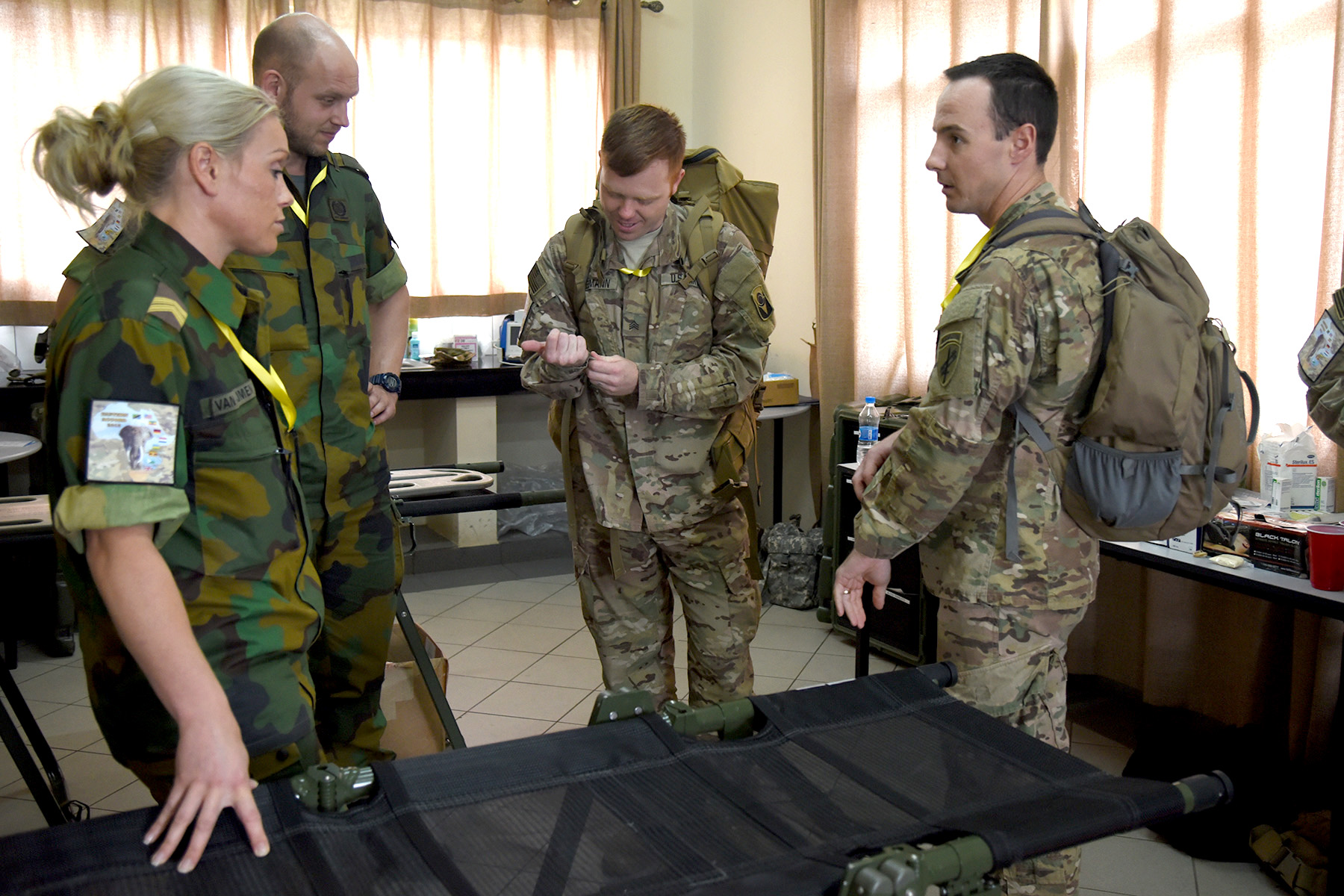 DAR ES SALAAM, Tanzania – Dutch and U.S. Eastern Accord medical personnel prepare for a tactical casualty care exercise at the Tanzanian Peacekeeping Training Centre, July 15, 2016, in Dar es Salaam, Tanzania. The medical team supports approximately 200 personnel for the annual, combined, joint military exercise that brings together nine partner nations to practice and demonstrate proficiency in conducting peacekeeping operations. (U.S. Air Force photo by Staff Sgt. Tiffany DeNault)