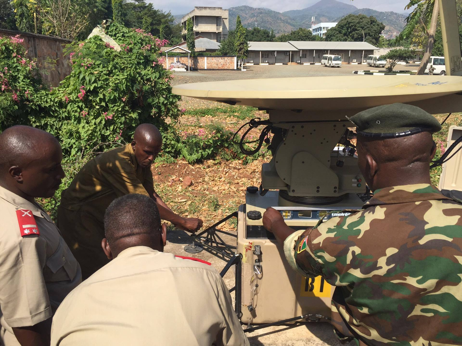 Burundian National Defense Force Soldiers work together to install their African Data Sharing Network terminal June 8-17, 2016, at Bujumbura, Burundi. Combined Joint Task Force–Horn of Africa communication Soldiers led a sharing of best practices for installing, operating, and maintaining their ADSN satellite terminal.  The ADSN communication package provides a dynamic intelligence sharing platform for the African Union Mission in Somalia's troop contributing countries. (U.S. Army photo by 1st Lt. Justin R. Klatt)