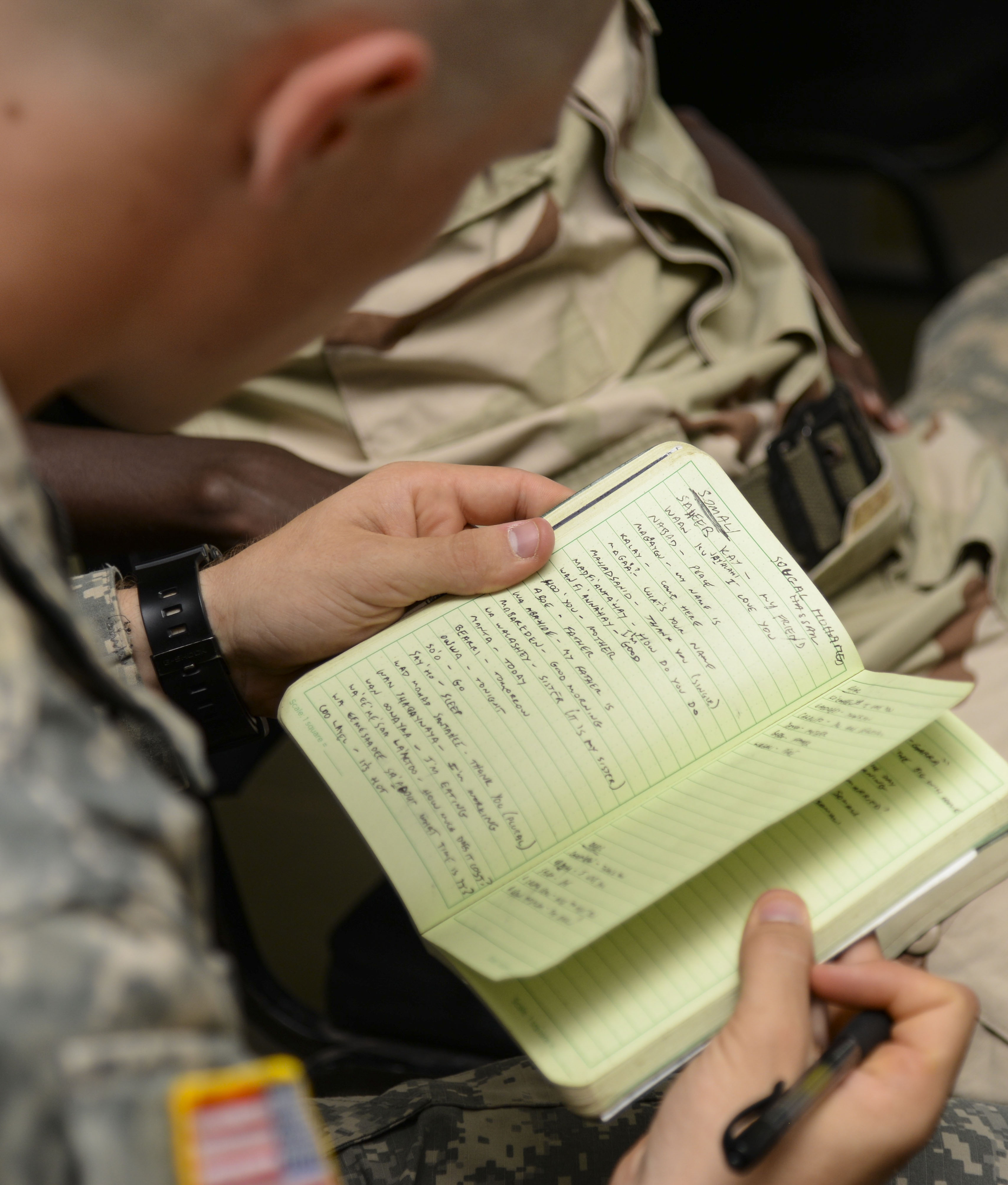 Michael Moser, a U.S. Army Reserve Officer Training Corps cadet from Seattle University, reviews vocabulary words learned during a language exchange program at the Djiboutian Military Academy at Arta, Djibouti, July 25, 2016. The cadets are spending three weeks with the Djiboutian Army in a culture exchange program, where they are learning each other's language and methods of military operations. (U.S. Air Force photo by Staff Sgt. Benjamin Raughton/Released)