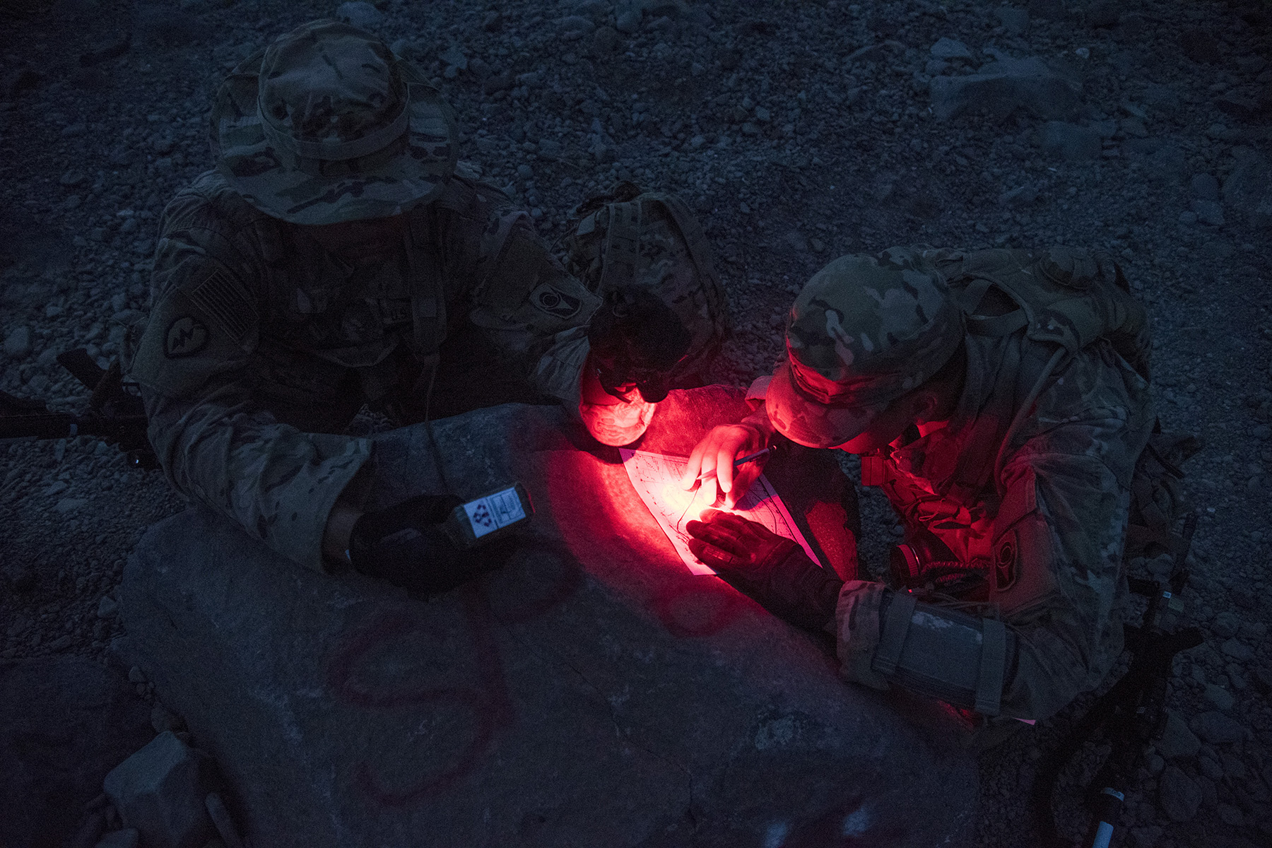ARTA, DJIBOUTI- U.S. Army soldiers from the Alpha Company, 1st Battalion, 124th Infantry Regiment, plot out the first of three navigation points during night land navigation training, Aug. 5, 2016, in Arta, Djibouti. The soldiers completed day and night land navigation training along with mock casualty care, simulating calling for fire support and assembly and disassembly of the M4 carbine rifle. (U.S. Air Force photo by Staff Sgt. Tiffany DeNault)
