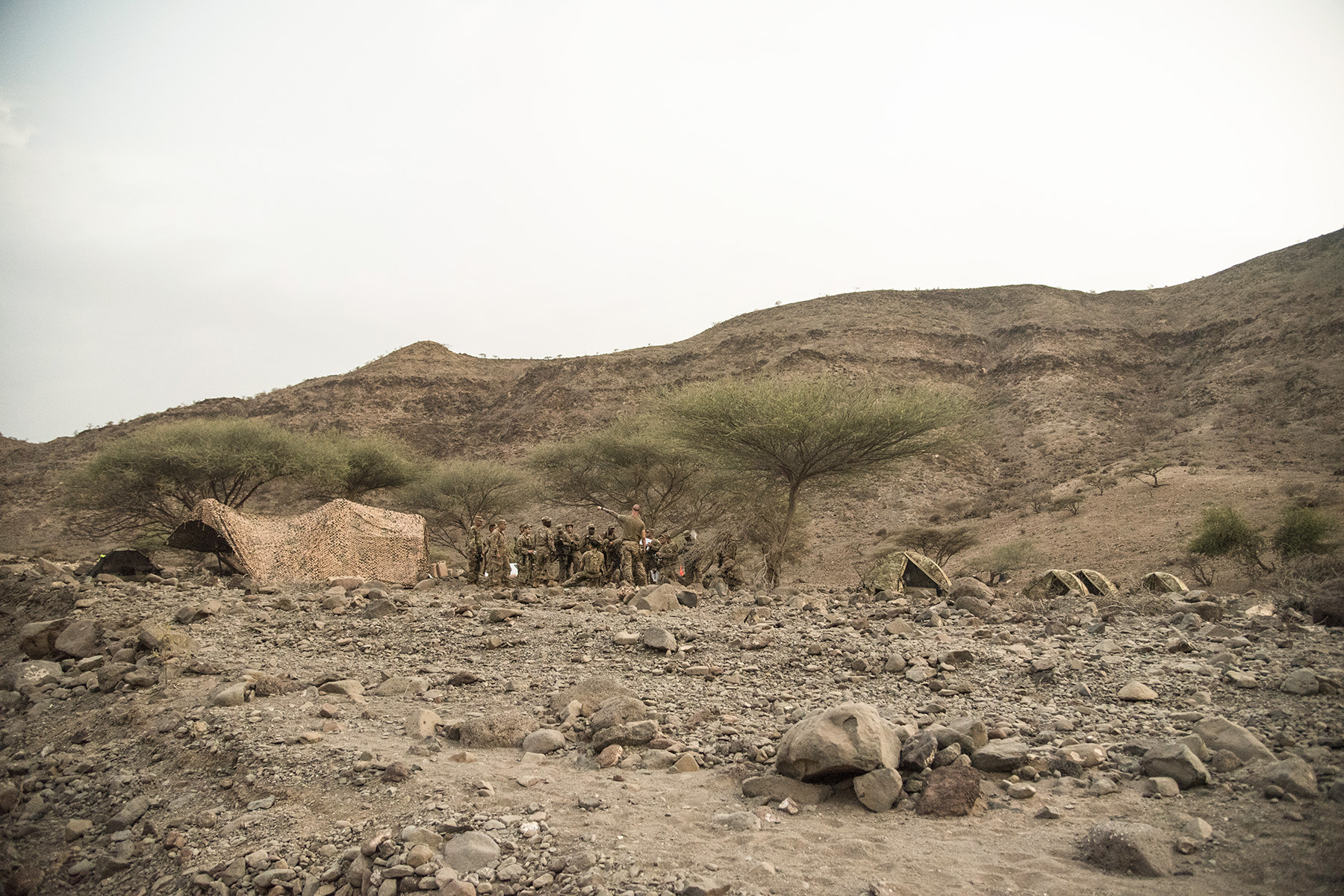 ARTA, DJIBOUTI- U.S. Army soldiers from the Alpha Company, 1st Battalion, 124th Infantry Regiment, participate in land navigation training, Aug. 5, 2016, in Arta, Djibouti. The soldiers completed day and night land navigation training along with mock casualty care, simulating calling for fire support and assembly and disassembly of the M4 carbine rifle. (U.S. Air Force photo by Staff Sgt. Tiffany DeNault)