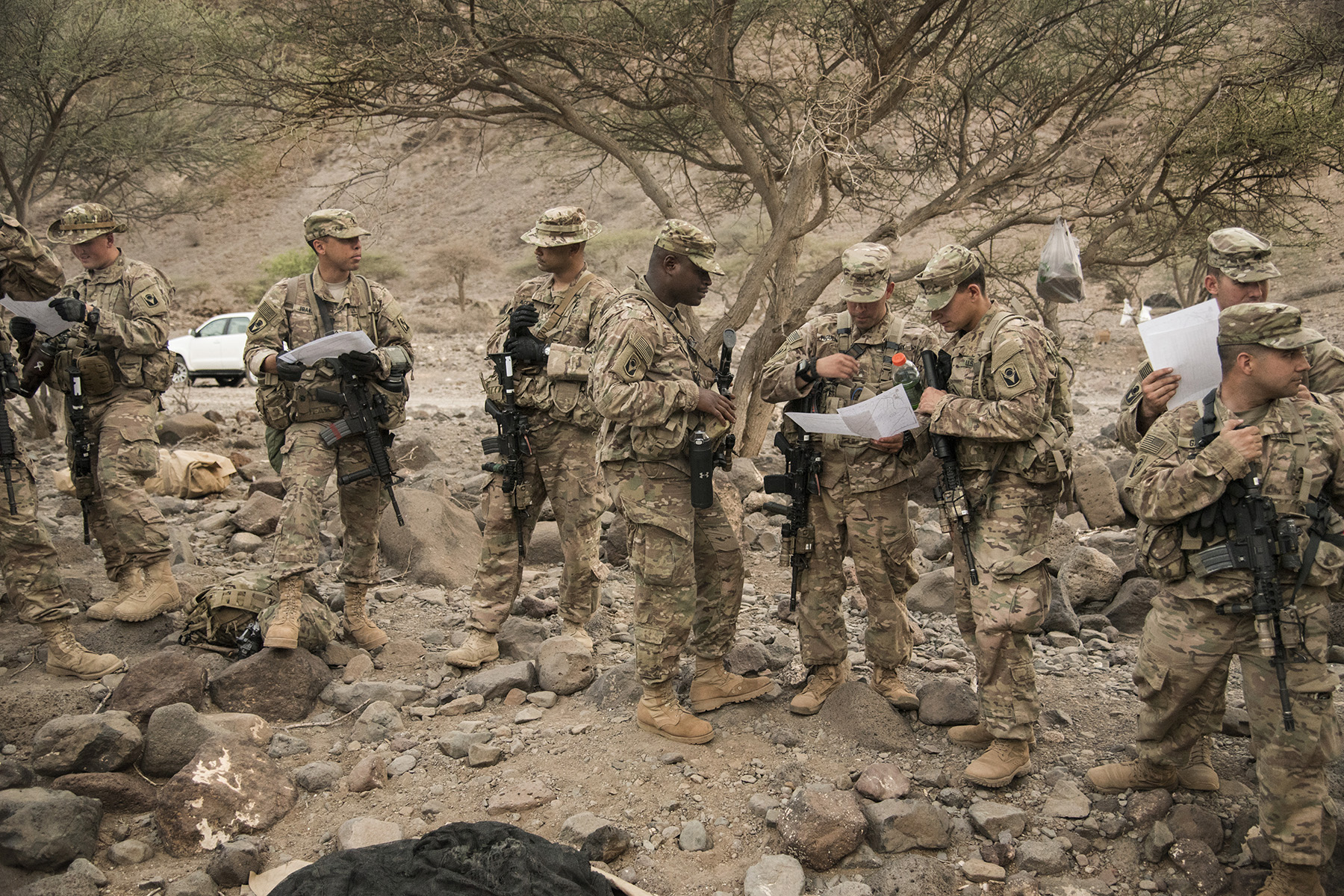 ARTA, DJIBOUTI- U.S. Army soldiers from the Alpha Company, 1st Battalion, 124th Infantry Regiment, receive location points during night land navigation training, Aug. 5, 2016, in Arta, Djibouti. The soldiers completed day and night land navigation training along with mock casualty care, simulating calling for fire support and assembly and disassembly of the M4 carbine rifle. (U.S. Air Force photo by Staff Sgt. Tiffany DeNault)